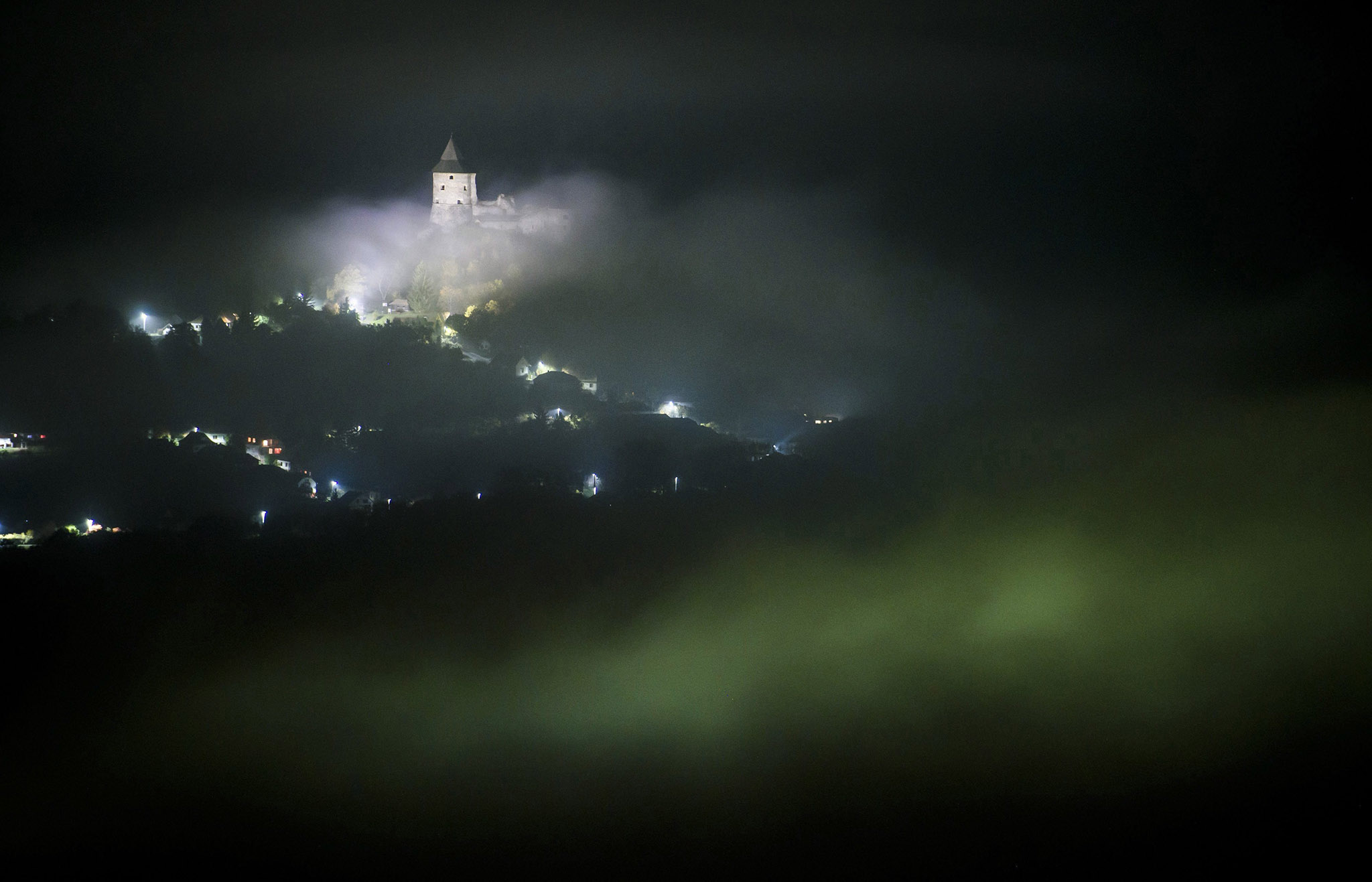 Clouds float above the Castle of Somosko near Salgotarjan, 109 kms northeast of Budapest, Hungary, Tuesday, lOct. 25, 2016. (Peter Komka/MTI via AP)