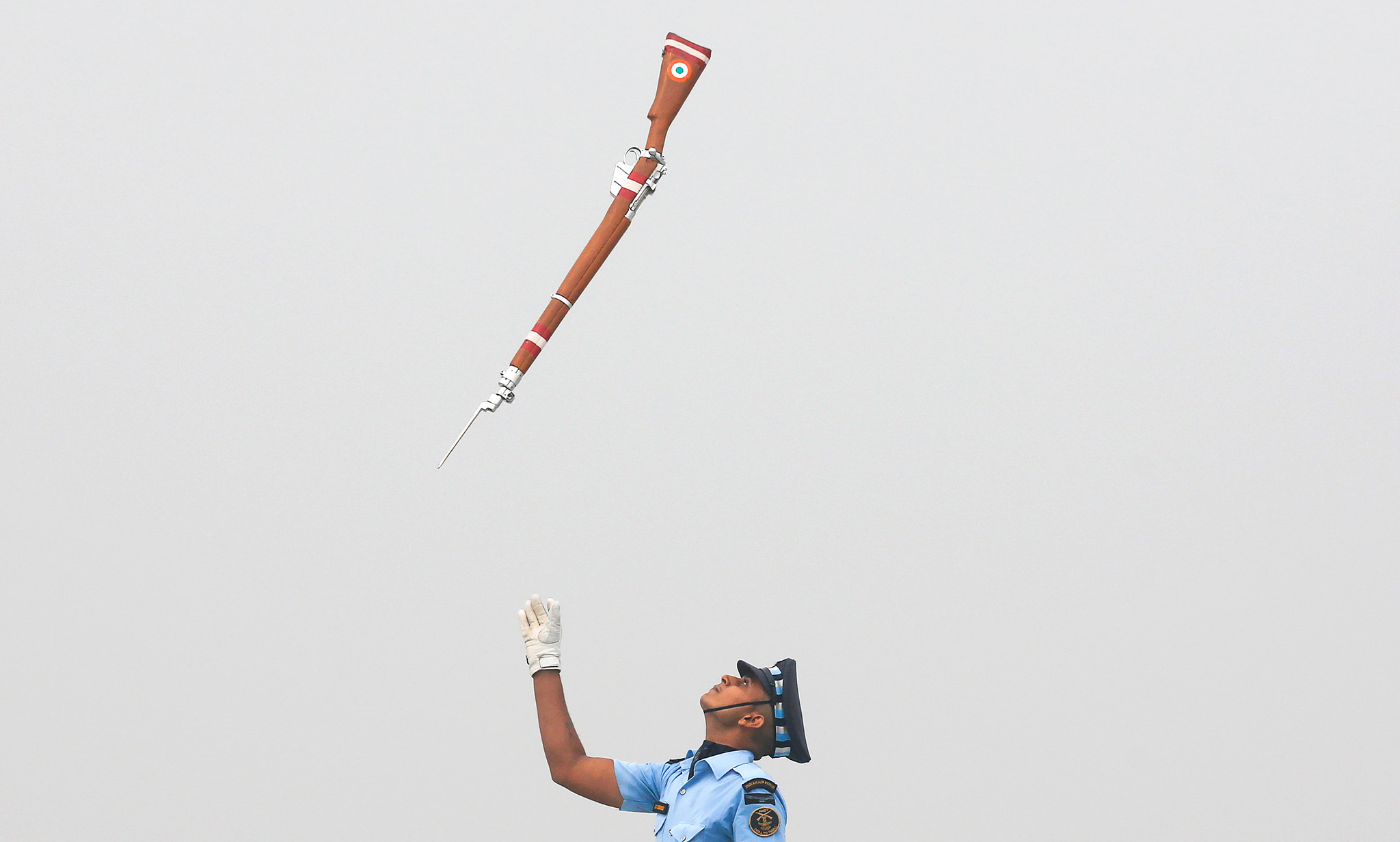 An Indian Air Force soldier tosses his rifle as he performs during the full-dress rehearsal for Indian Air Force Day at the Hindon air force station on the outskirts of New Delhi, India, October 6, 2016.