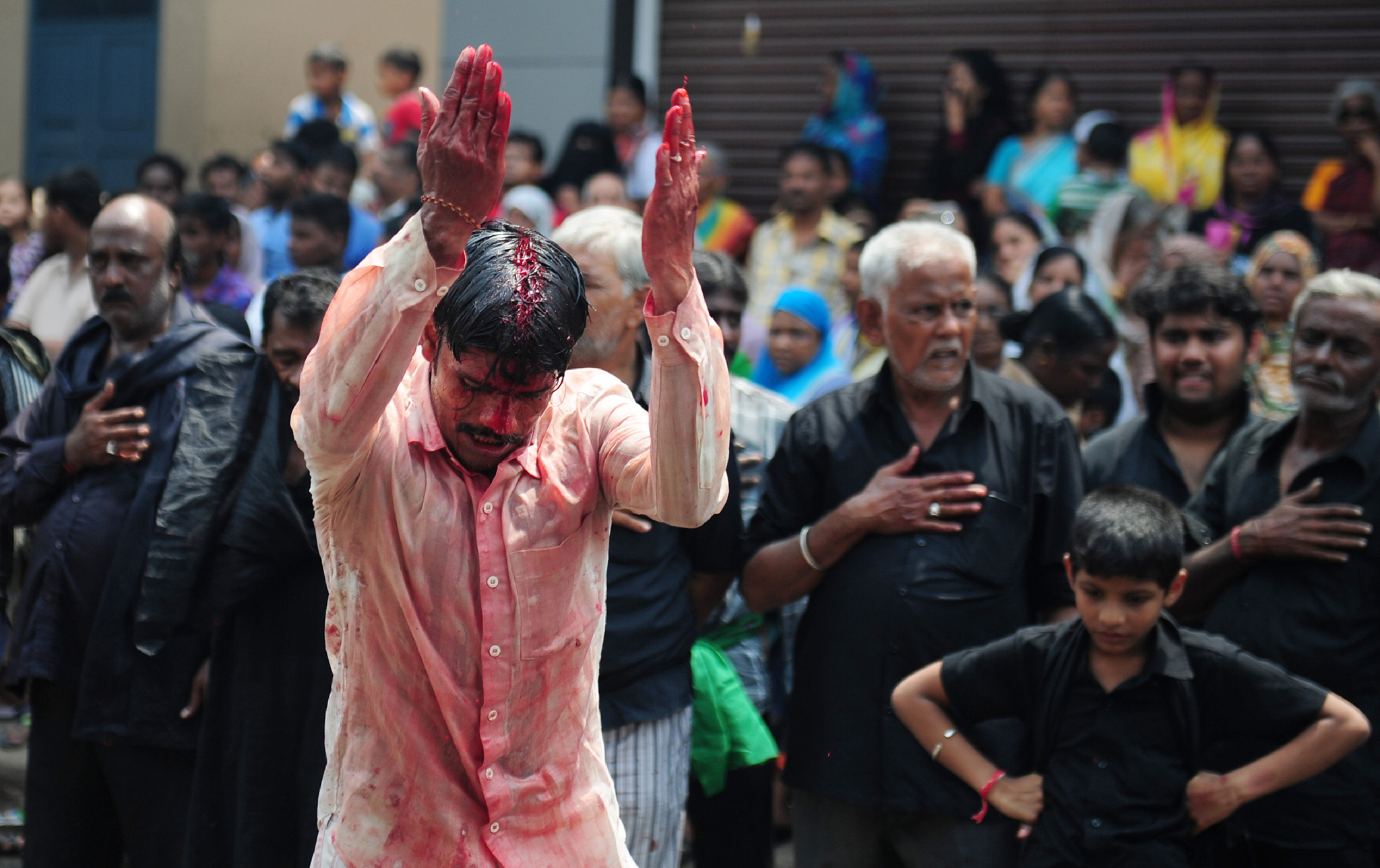 Indian Shia Muslim men flagellate themselves during the mourning procession on the tenth day of Muharram, which marks the day of Ashura, in Chennai on October 12, 2016. Ashura mourns the death of Imam Hussein, a grandson of the Prophet Mohammed, who was killed by armies of the Yazid near Karbala in 680 AD. / AFP PHOTO / ARUN SANKARARUN SANKAR/AFP/Getty Images