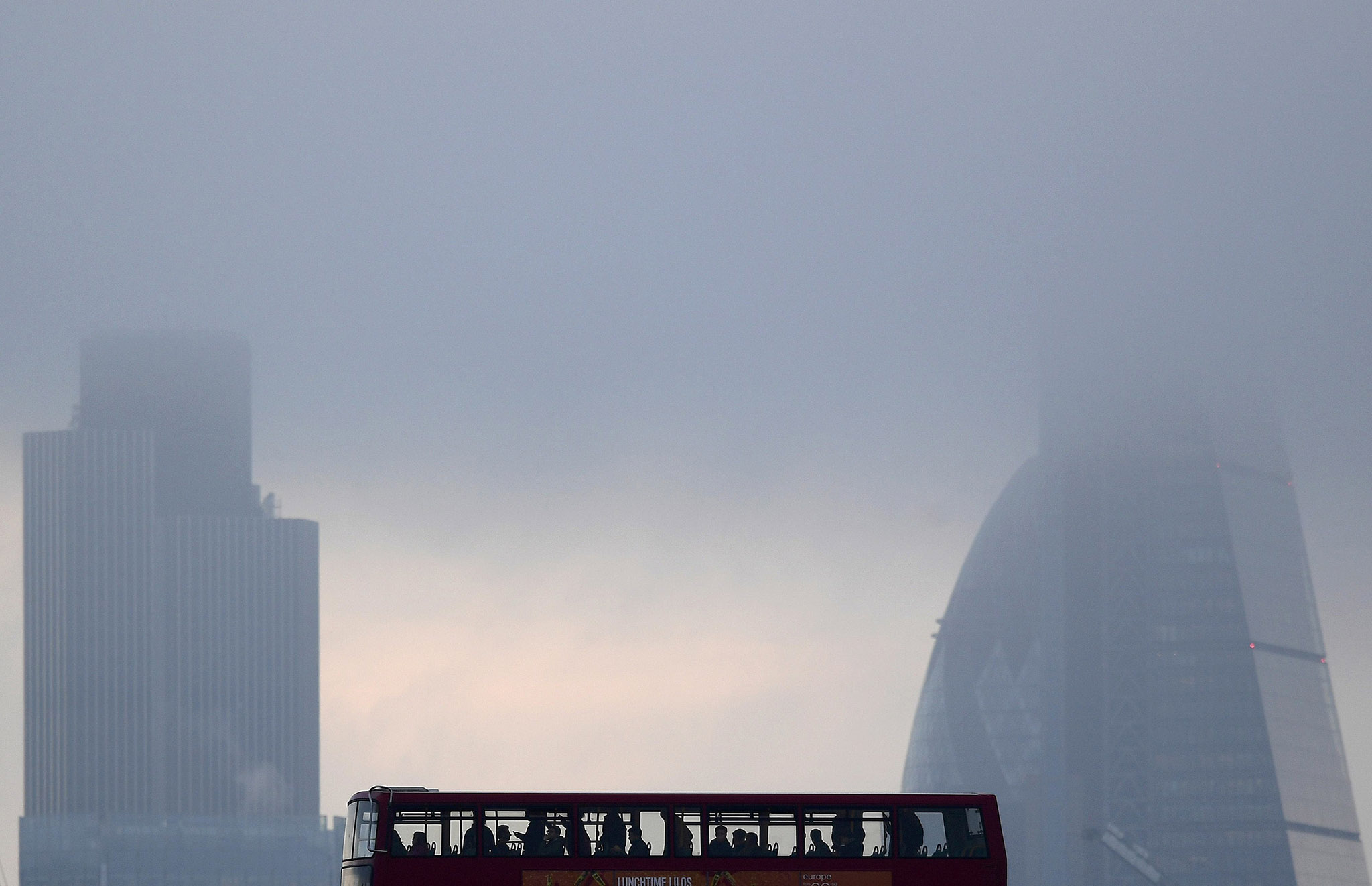 City workers cross the River Thames with the City of London financial district seen behind in London, in Britain October 27, 2016. REUTERS/Toby Melville