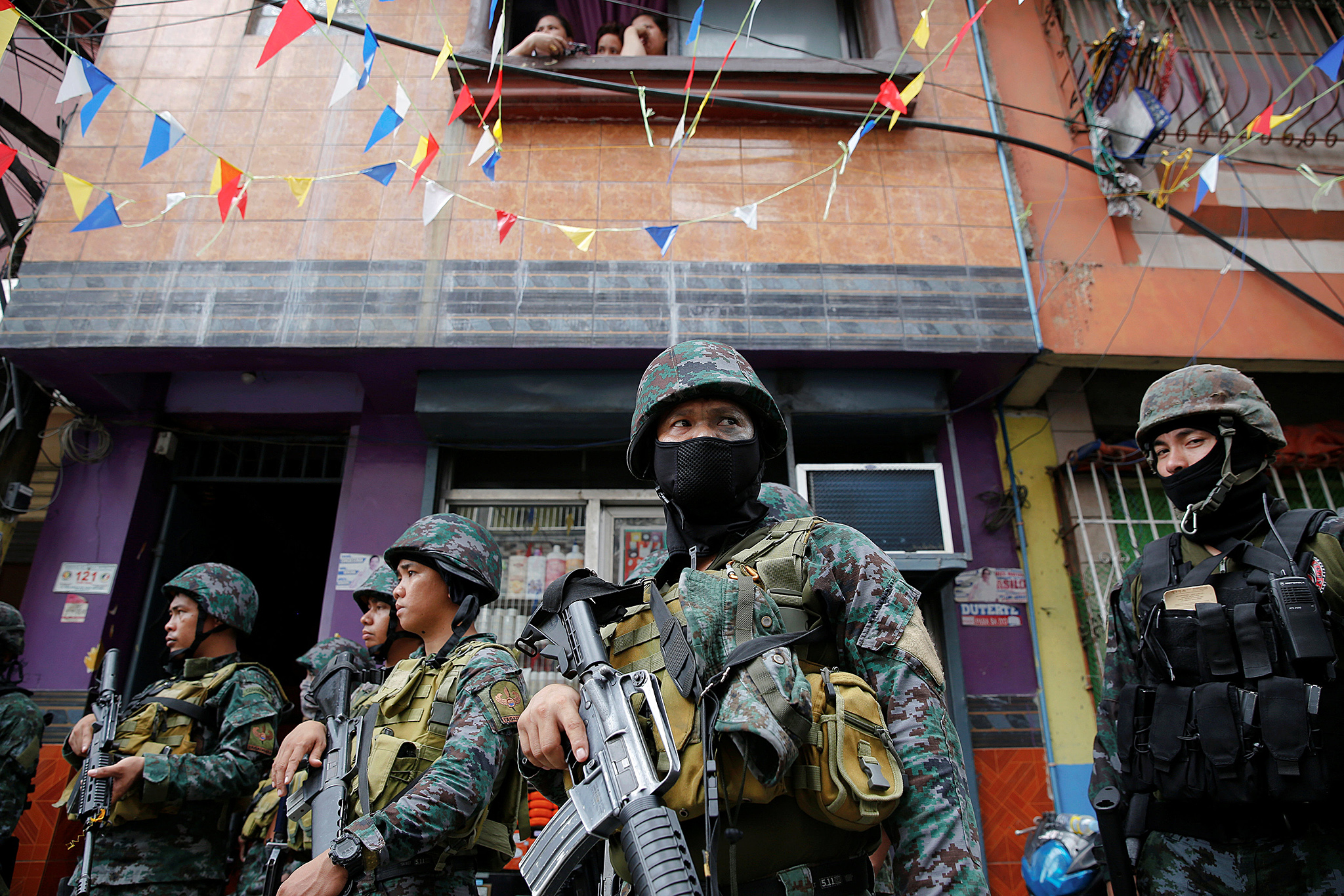 Armed security forces take a part in a drug raid, in Manila, Philippines,