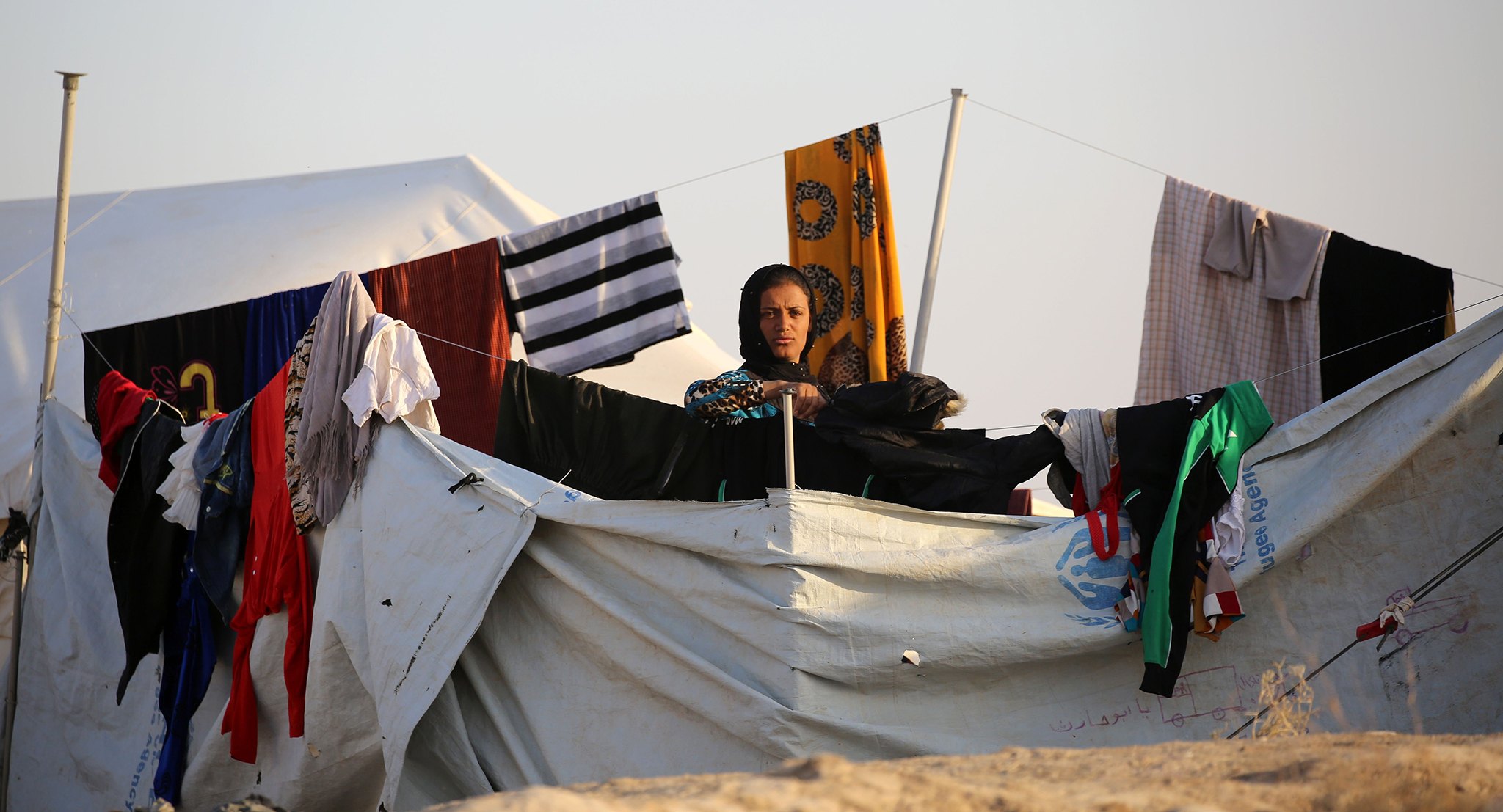 A woman poses at a refugee camp housing Iraqi families who fled fighting in the Mosul area on October 17, 2016 in the northeastern town of al-Hol in Syria's Hasakeh province.  The battle to retake the Iraqi city of Mosul from jihadists could unleash a massive humanitarian crisis, potentially pushing hundreds of thousands to flee their homes as winter sets in. / AFP PHOTO / DELIL SOULEIMANDELIL SOULEIMAN/AFP/Getty Images