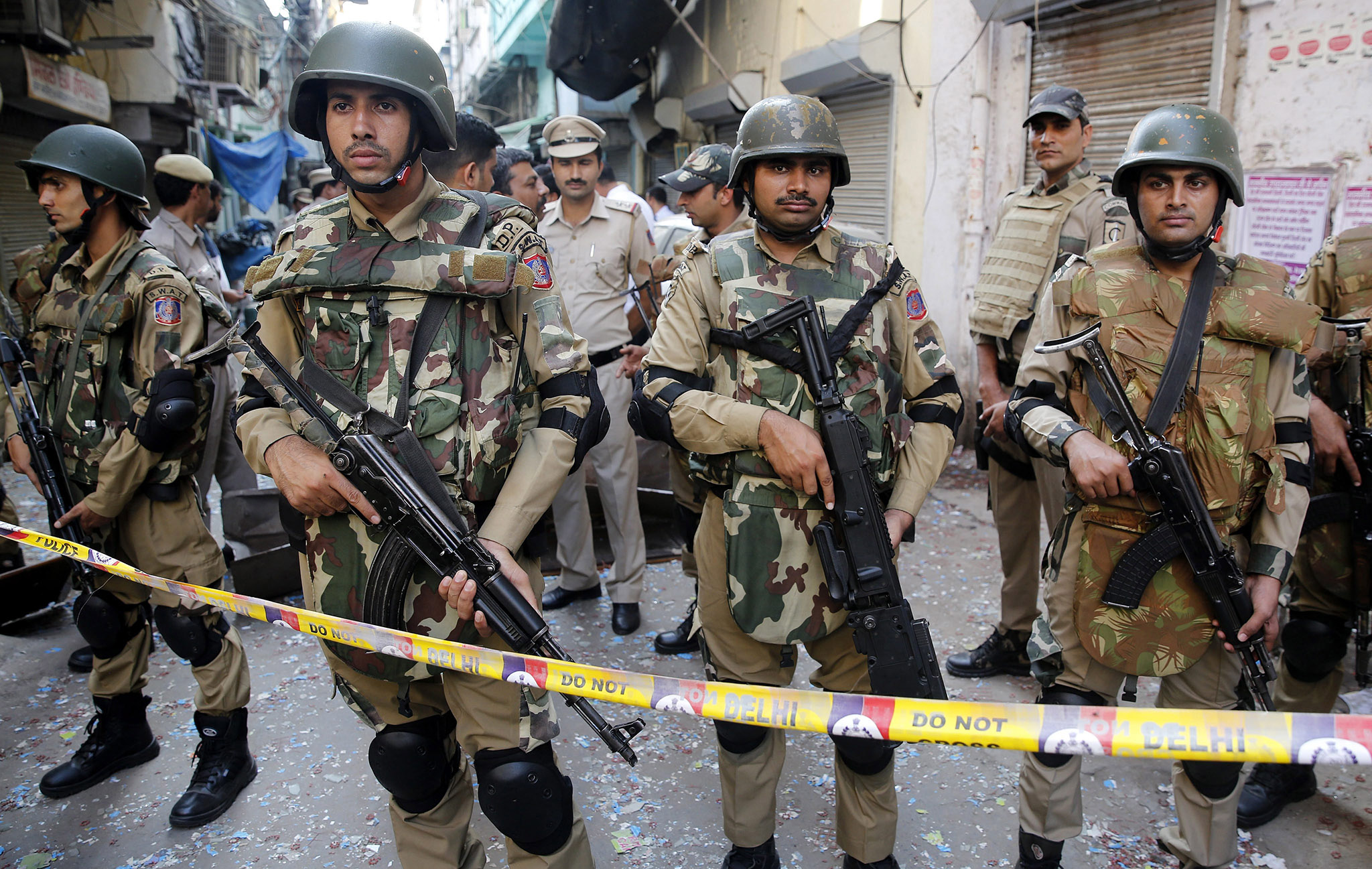 Indian Police officials guard the spot after an explosion in a market in Chandni Chowk area in New Delhi, India, 25 October 2016. Reports state one person was killed and five others injured in the explosion. Initial investigation revealed the explosion could be due to materials used in crackers that were possibly in a bag with the man who died in the incident.  EPA/RAJAT GUPTA