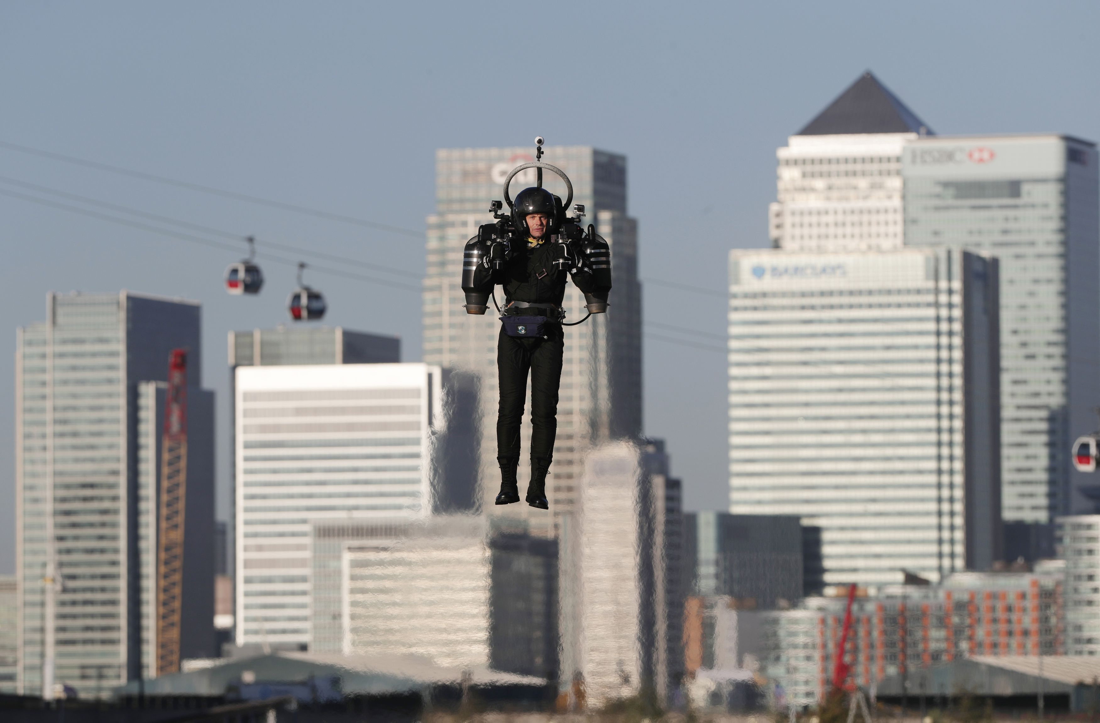 David Mayman pilots the JB-10 Jetpack flying machine over the Royal Victoria Docks in east London on its maiden flight in the UK to mark the launch of an equity crowdfunding campaign on Seedrs. PRESS ASSOCIATION Photo. Picture date: Wednesday October 5, 2016. Light enough to be carried by one person, small enough to fit in a car, and with a flight time of up to 10 minutes at speeds of up of 60mph, the JB-10 has a wide range of potential applications and commercial uses. See PA story TRANSPORT Jetpack. Photo credit should read: Yui Mok/PA Wire