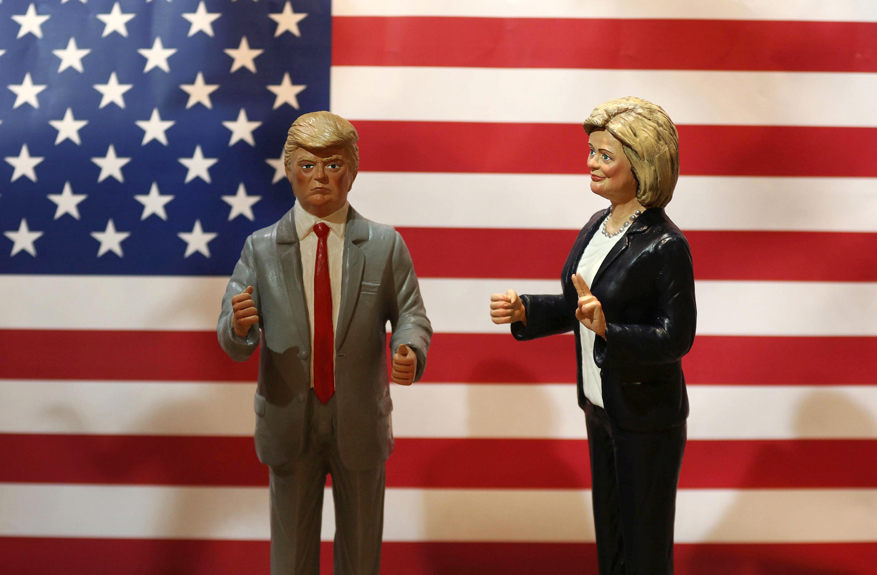 Statuettes depicting the presidential candidates Donald Trump, left, and Hillary Clinton are displayed in a shop in the renown Via San Gregorio Armeno, street of nativity scene craftsmen, in Naples, Italy, Tuesday, Oct. 18, 2016. On Nov. 8, Americans will vote for their next president. (Cesare Abbate/ANSA via AP)