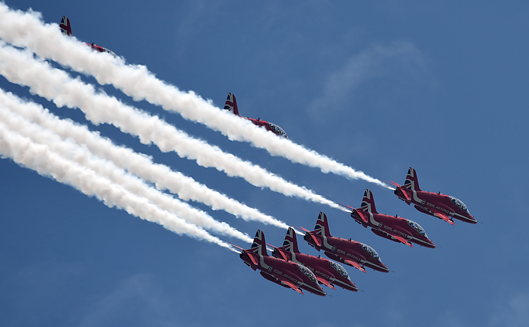 The Red Arrows aerobatic team of Britain's Royal Air Force flies over the Marina Barrage in Singapore on October 18, 2016.   The flypast which had previously been delayed twice due to inclement weather finally made their way fly past over Marina Bay on October 18, in Singapore for 20-minutes. The visit to Singapore is part of the team's visit to the Middle East and Asia, to contribute to a campaign to showcase the best of what Britain has to offer. / AFP PHOTO / ROSLAN RAHMANROSLAN RAHMAN/AFP/Getty Images