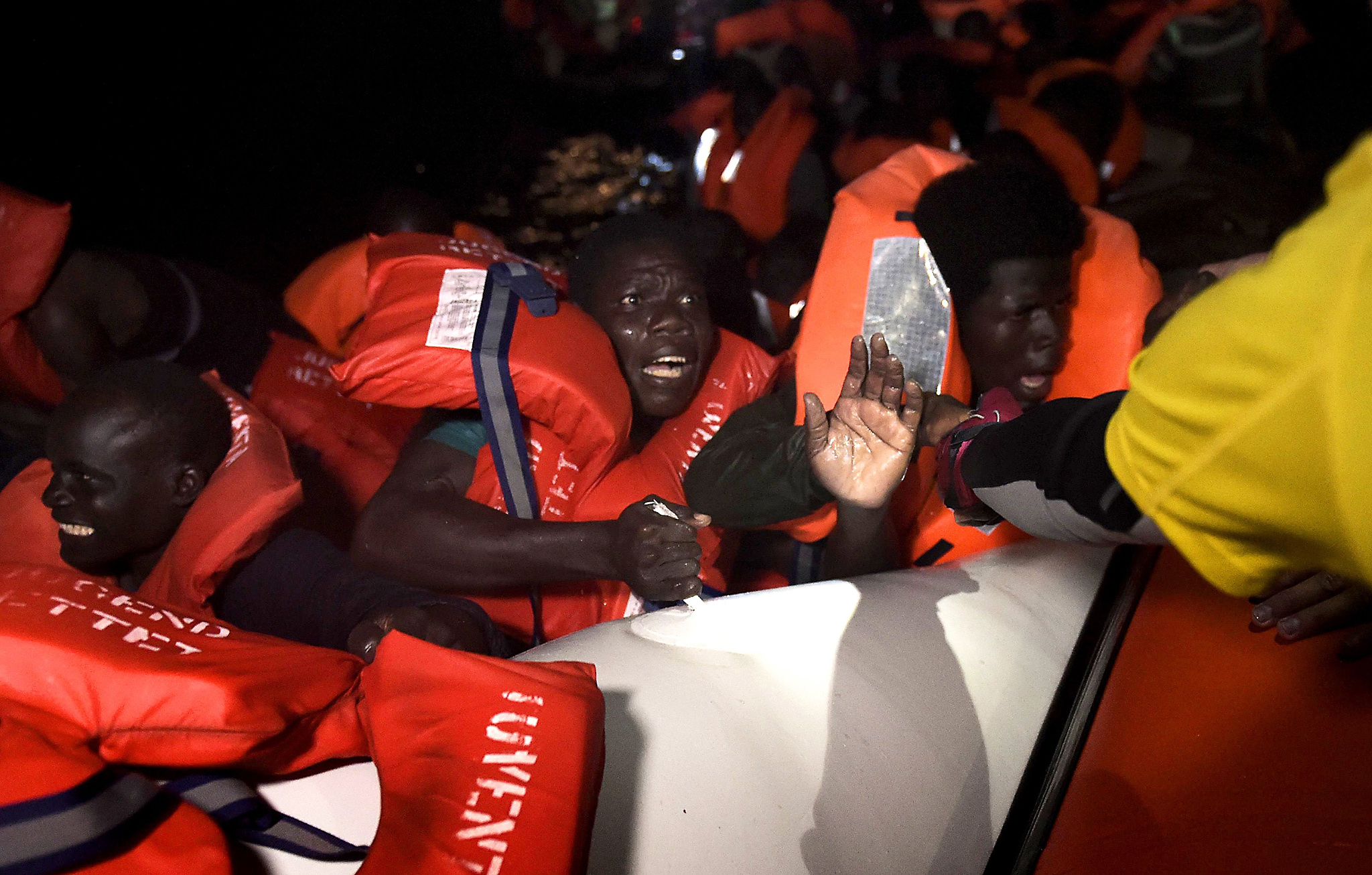 A migrant is rescued after the rubber boat he was in sunk some eight nautical miles off Libya's Mediterranean coastline on October 12, 2016. A growing number of people are attempting the treacherous sea journey from Libya or Egypt, after the closure of the Balkan migrant trail route leading from Greece to western Europe. / AFP PHOTO / ARIS MESSINISARIS MESSINIS/AFP/Getty Images