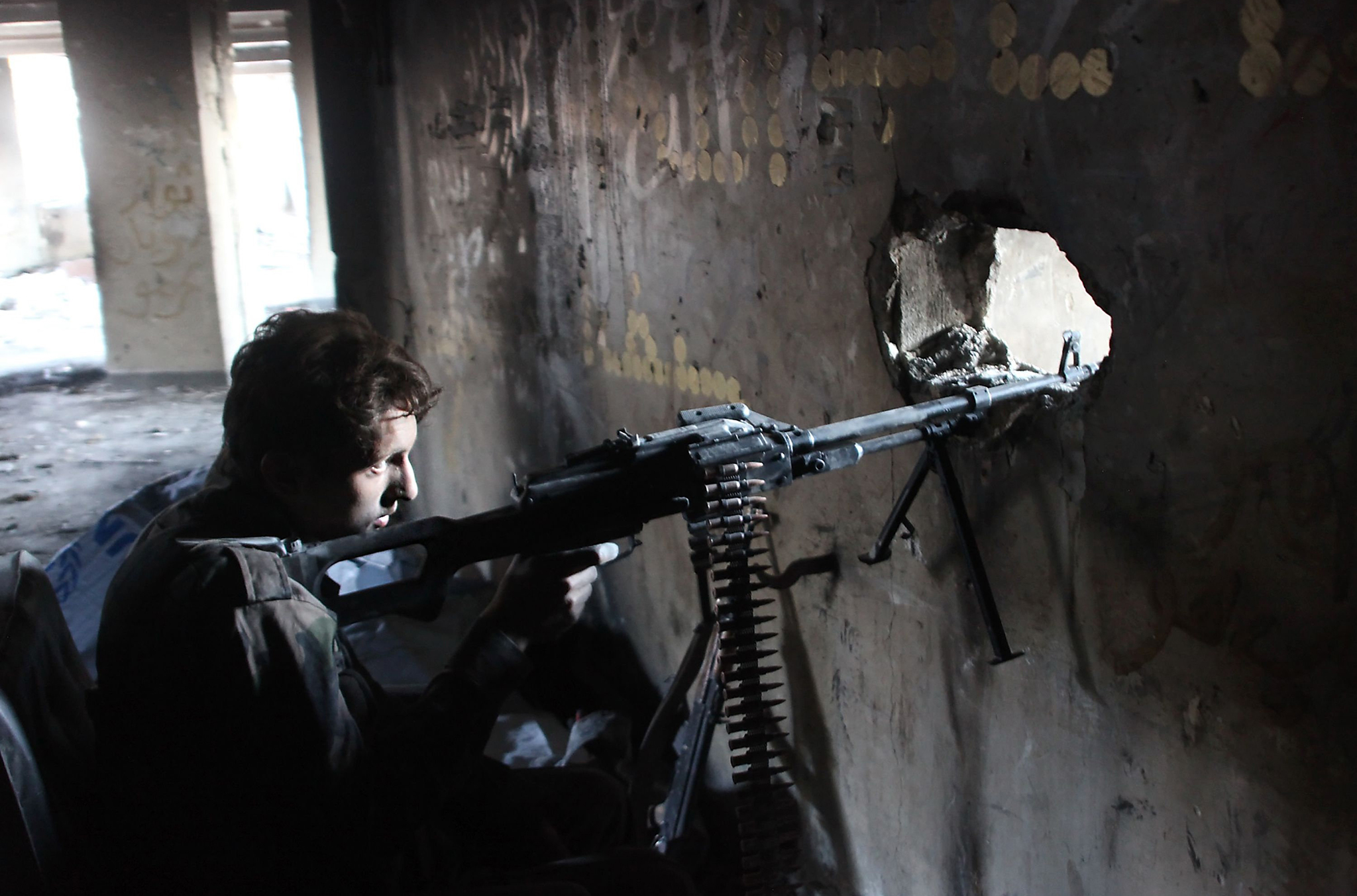 "A member of Syria's pro-government forces guards a look out point as they advance Aleppo's rebel-held Bustan al-Basha neighbourhood on October 6, 2016. ""Syrian regime forces advanced from the city centre north into (rebel-held) Bustan al-Basha, and seized a large athletic complex there,"" the UK-based Syrian Observatory for Human Rights said. This was the first time the regime had entered the district since 2013 and there had been fierce clashes, they added.      This was the first time the regime had entered the district since 2013 and there had been fierce clashes, he added.   / AFP PHOTO / GEORGE OURFALIANGEORGE OURFALIAN/AFP/Getty Images"
