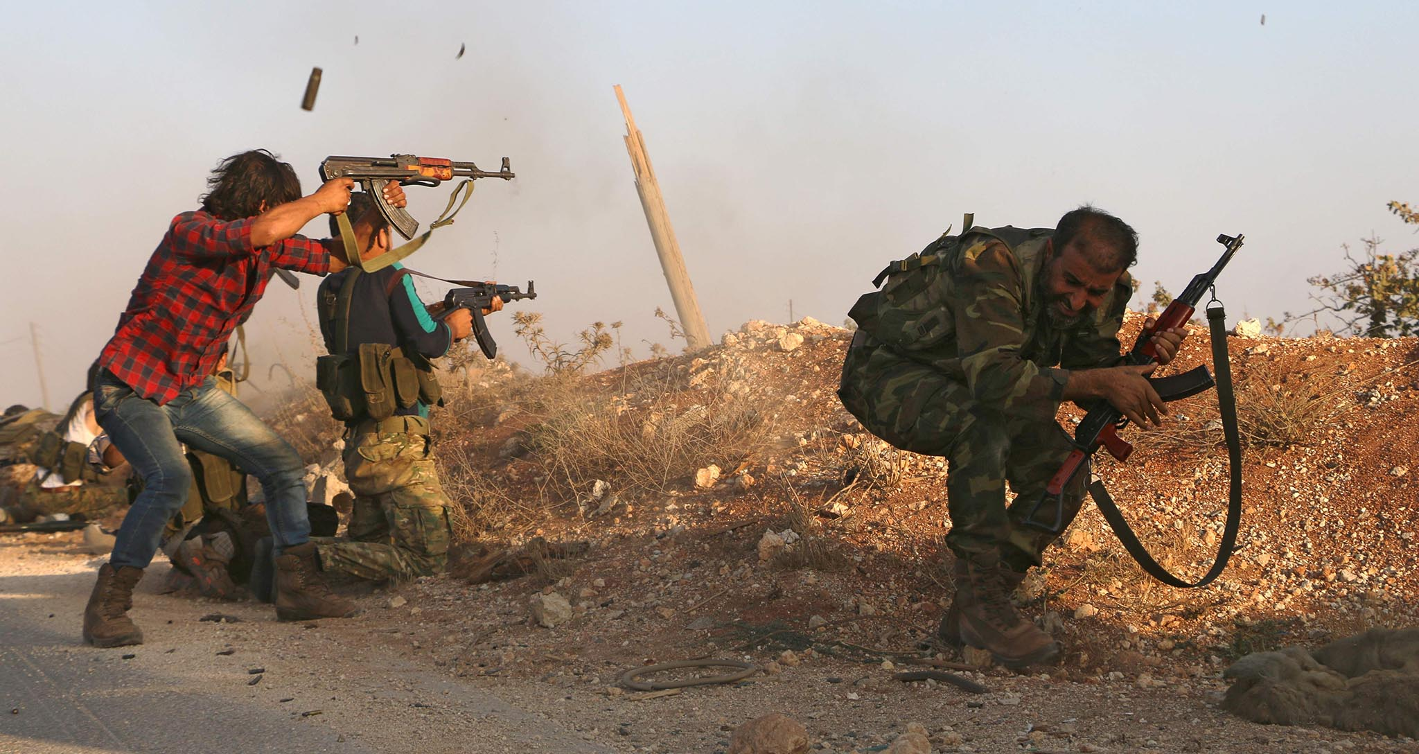 Fighters from the Free Syrian Army take part in a battle against the Islamic State (IS) group jihadists in the northern Syrian village of Yahmoul in the Marj Dabiq area north of the embattled city of Aleppo on October 10, 2016.  Syria's main opposition group called Monday for foreign allies to supply rebel forces with ground-to-air weapons to counter deadly air raids in Aleppo.  / AFP PHOTO / Nazeer al-KhatibNAZEER AL-KHATIB/AFP/Getty Images
