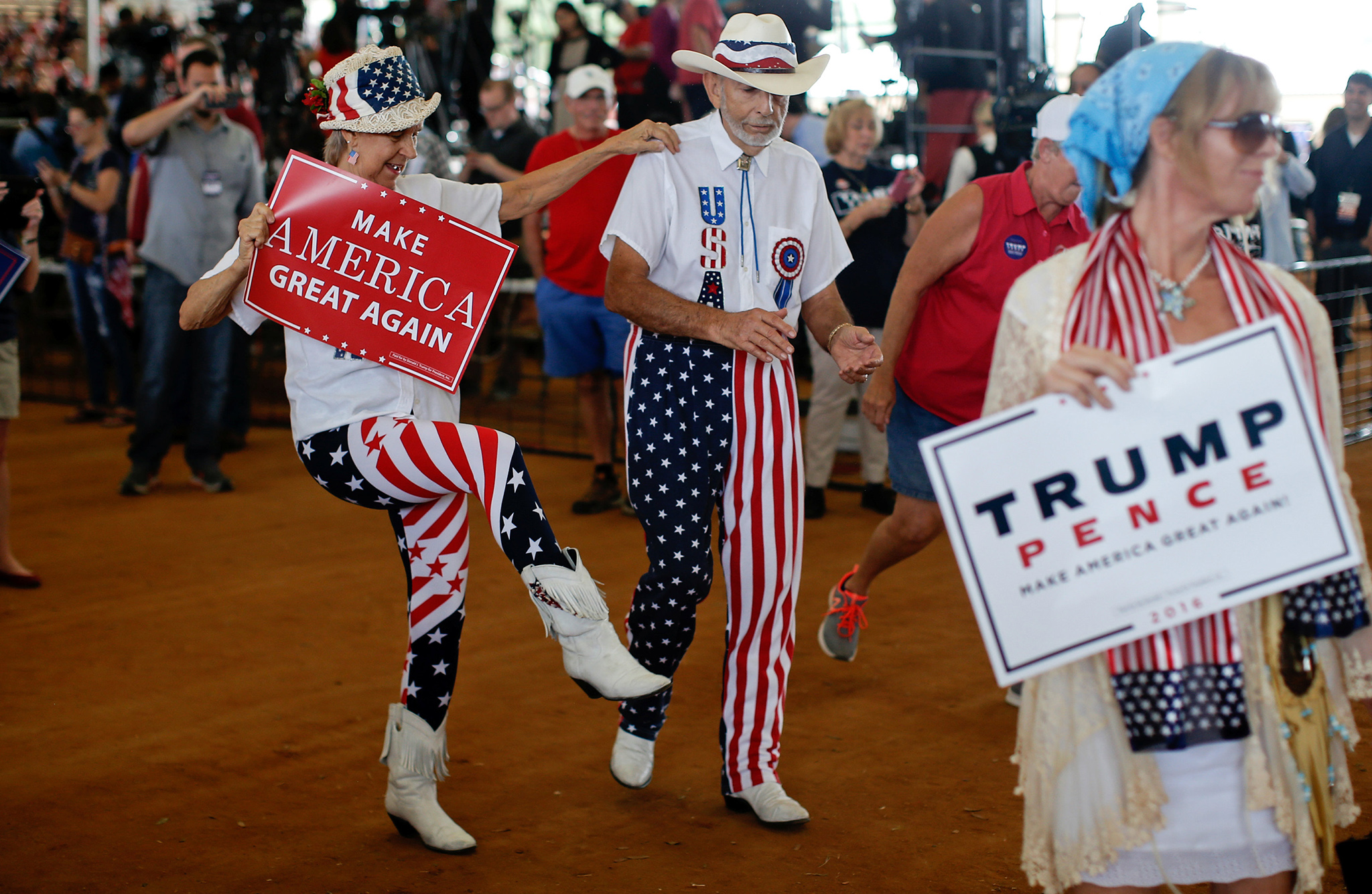 Supporters of Republican U.S. presidential nominee Donald Trump dance at a campaign rally in Ocala, Florida, U.S., October 12, 2016.   REUTERS/Mike Segar
