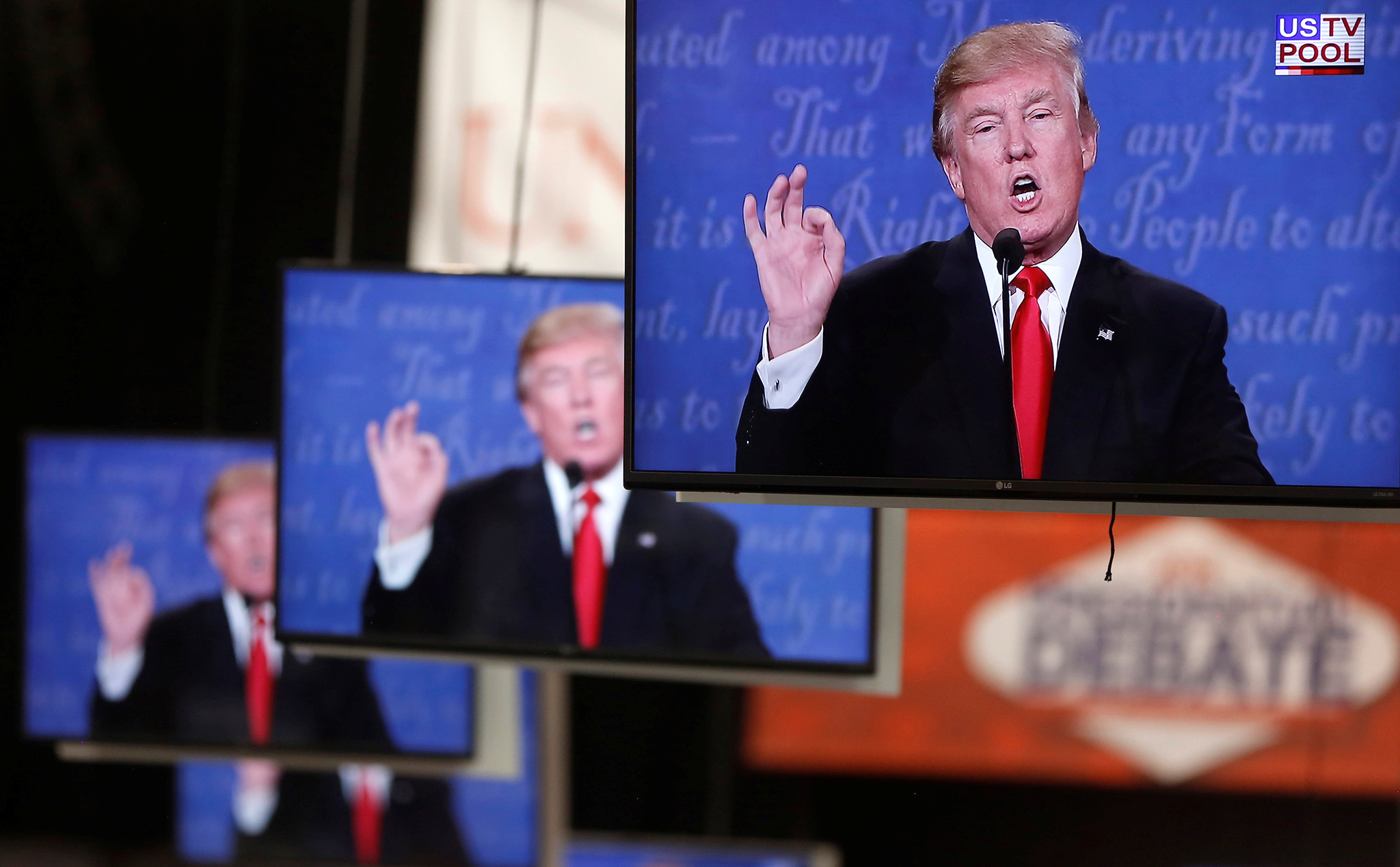 Republican U.S. presidential nominee Donald Trump is shown on TV monitors in the media filing room on the campus of University of Nevada, Las Vegas, during the last 2016 U.S. presidential debate in Las Vegas, U.S., October 19, 2016. REUTERS/Jim Urquhart TPX IMAGES OF THE DAY