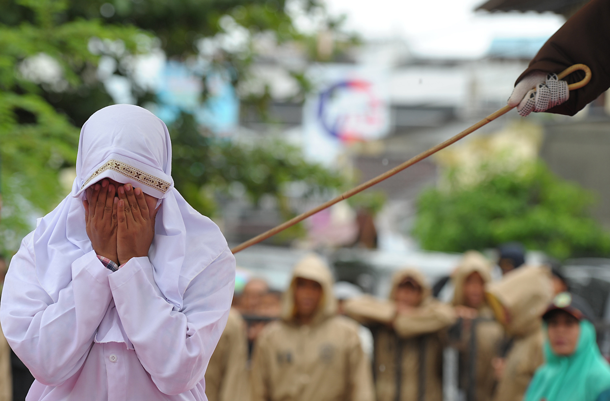 A Muslim woman gets caned 23 strokes after being caught in close proximity with her boyfriend in Banda Aceh on October 17, 2016.   Out of seven couples caught spending time together outside marriage, 13 were caned while one girl was spared after it was discovered that she was pregnant. Indonesia's Aceh province has gained international infamy for its strict Islamic laws. / AFP PHOTO / CHAIDEER MAHYUDDIN / The erroneous mention[s] appearing in the metadata of this photo by CHAIDEER MAHYUDDIN has been modified in AFP systems in the following manner: [woman] instead of [girl]. Please immediately remove the erroneous mention[s] from all your online services and delete it (them) from your servers. If you have been authorized by AFP to distribute it (them) to third parties, please ensure that the same actions are carried out by them. Failure to promptly comply with these instructions will entail liability on your part for any continued or post notification usage. Therefore we thank you very much for all your attention and prompt action. We are sorry for the inconvenience this notification may cause and remain at your disposal for any further information you may require.CHAIDEER MAHYUDDIN/AFP/Getty Images