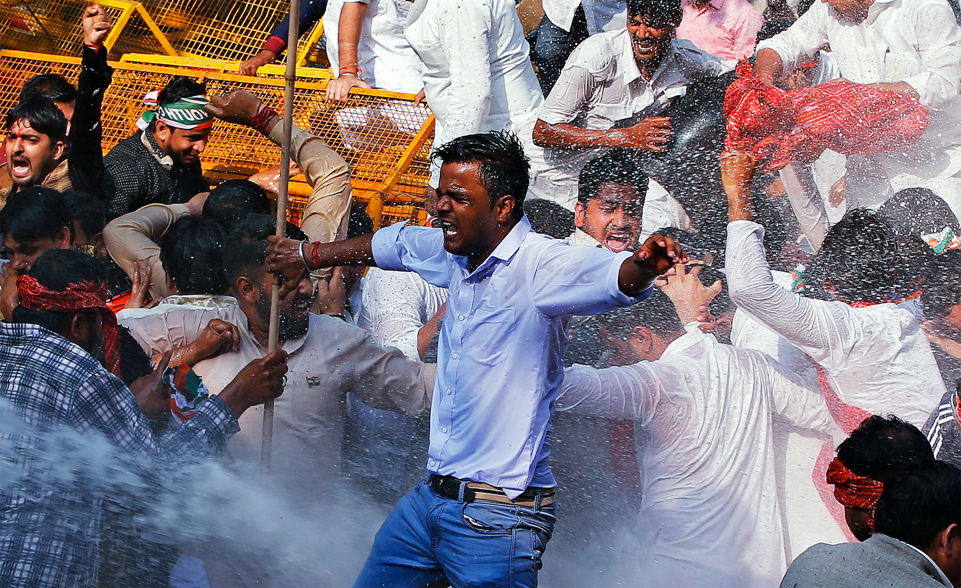 Police use water cannon to disperse activists of the youth wing of India's main opposition Congress party during a protest in New Delhi