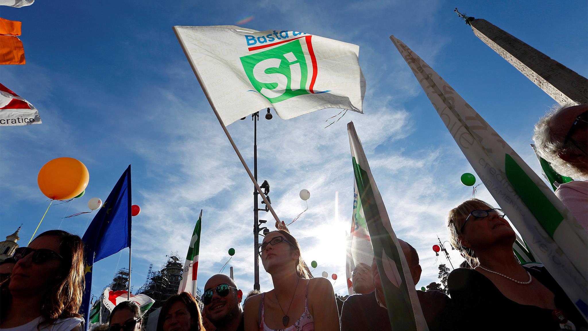 Supporters wave flags during a rally led by Italian PM Renzi in downtown Rome
