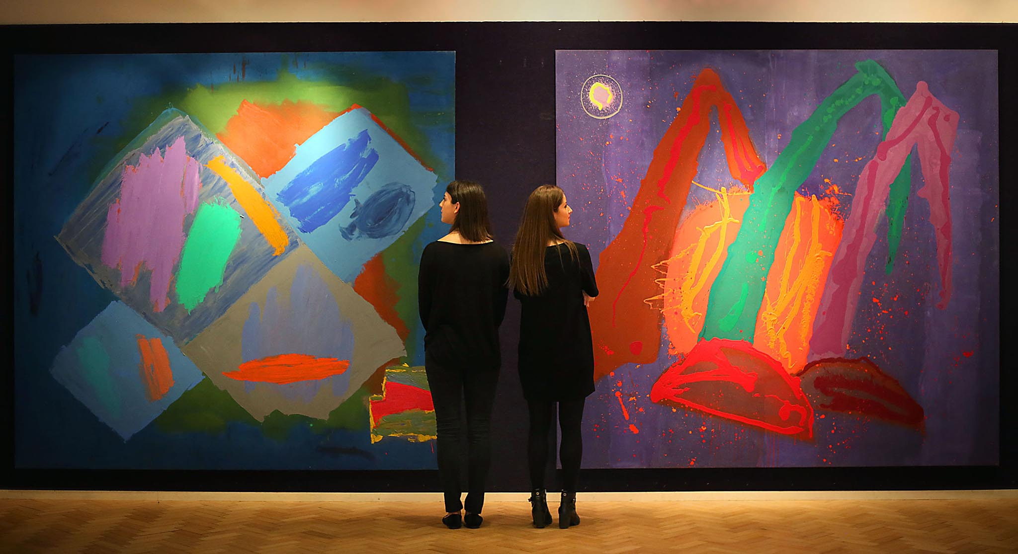 Art handlers Lorna Cumming-Bruce (left) and Sarah Gubbins at Bonhams in London with paintings by John Hoyland, Harvest (left) estimated at £30-50,000 and New Born Sun (rising) estimated at £25-35,000 which will be auctioned at the Bonhams Modern British and Irish Art Sale on November 23rd in London. PRESS ASSOCIATION Photo. Picture date: Monday November 21, 2016. Photo credit should read: Philip Toscano/PA Wire