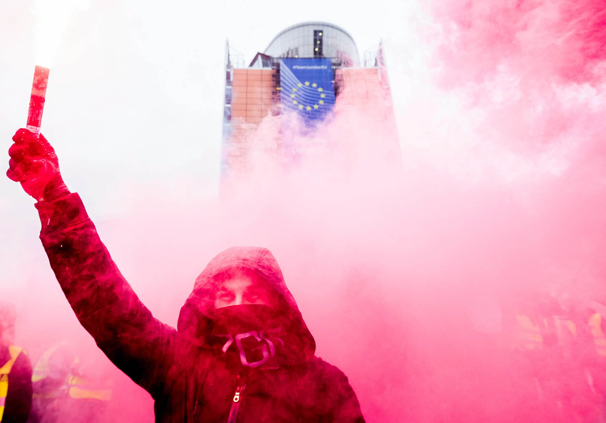 A protester lights a flare as he takes part in an european steel workers protest against China's dumping price in Brussels, Belgium, 09 November 2016. The demonstration of European Steel Association (EUROFER) and workers of steel industry has been organized following a severe downturn in the price of steel caused by a flood of imports into Europe from China.  EPA/STEPHANIE LECOCQ