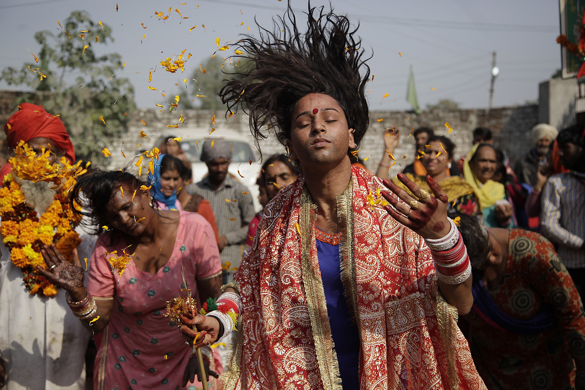 Devotees whirl their head as a ritualistic performance during the annual Jhiri Fair at Kanachack village, outskirts of Jammu, India, Monday, Nov.14, 2016. According to the villagers,  the fair is held in memory of Baba Jitu, an honest farmer who killed himself since he was not prepared to submit to the unjust demands of a landlord who wanted him to part with his crop. (AP Photo/Channi Anand)