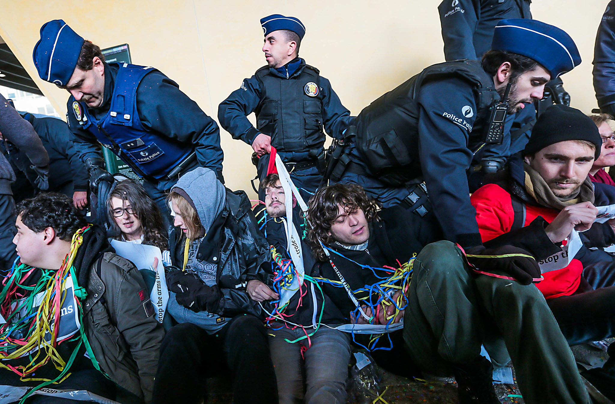 Police intervene when activists block the entrance of the European Commission while they protest in front of the building of the European Commission against the subsidies of Europe in the armaments industry in Brussels, Belgium, 10 November 2016. Police decide to close the neighborhood as a measure of security.  EPA/STEPHANIE LECOCQ
