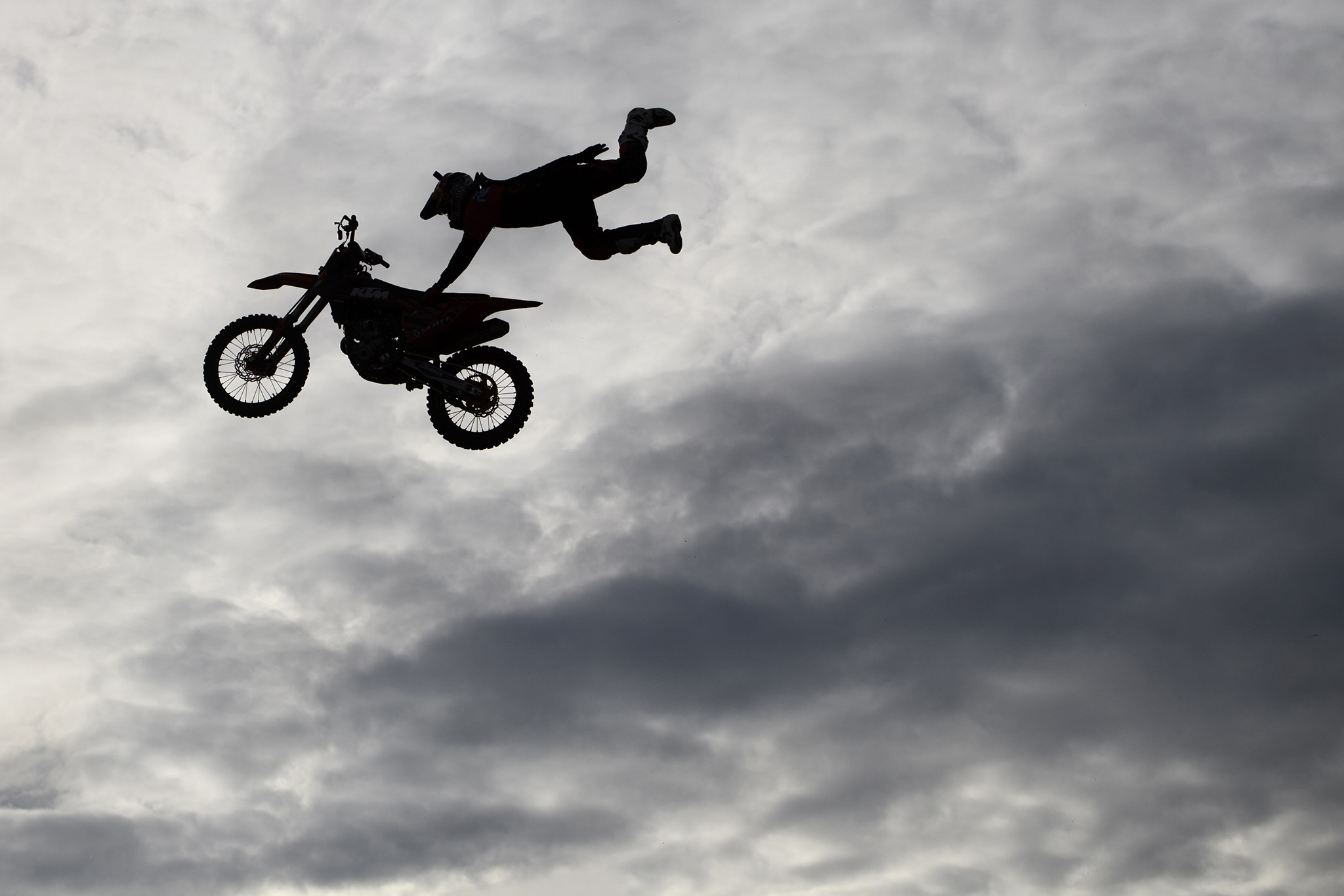 Swiss Freestyle Motocross  driver Mat Rebeaud performs a figure during a FMX jump training session ten days before the 31st Geneva International Supercross, in Payerne, Switzerland, Tuesday, Nov.22, 2016. (Laurent Gillieron/Keystone via AP)
