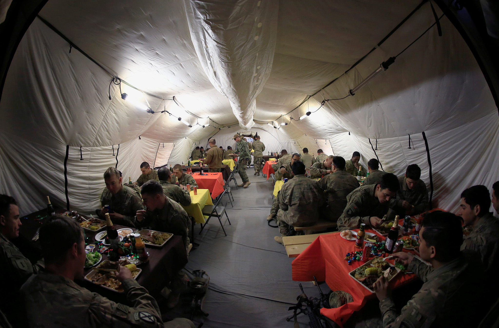 U.S. soldiers eat their meals to celebrate Thanksgiving Day inside the U.S. army base in Qayyara, south of Mosul, Iraq November 24, 2016.