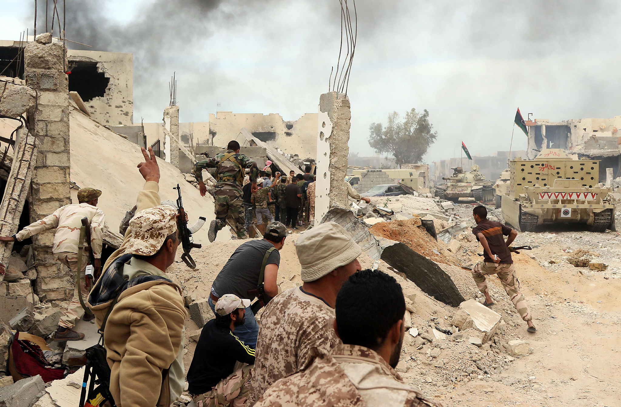 Forces loyal to Libya's Government of National Accord (GNA) hold a position amid the rubble of destroyed buildings in Sirte's Al-Giza Al-Bahriya district on November 21, 2016, during clashes with Islamic State (IS) group jihadists to retake control of the Mediterranean coastal city. / AFP PHOTO / MAHMUD TURKIAMAHMUD TURKIA/AFP/Getty Images