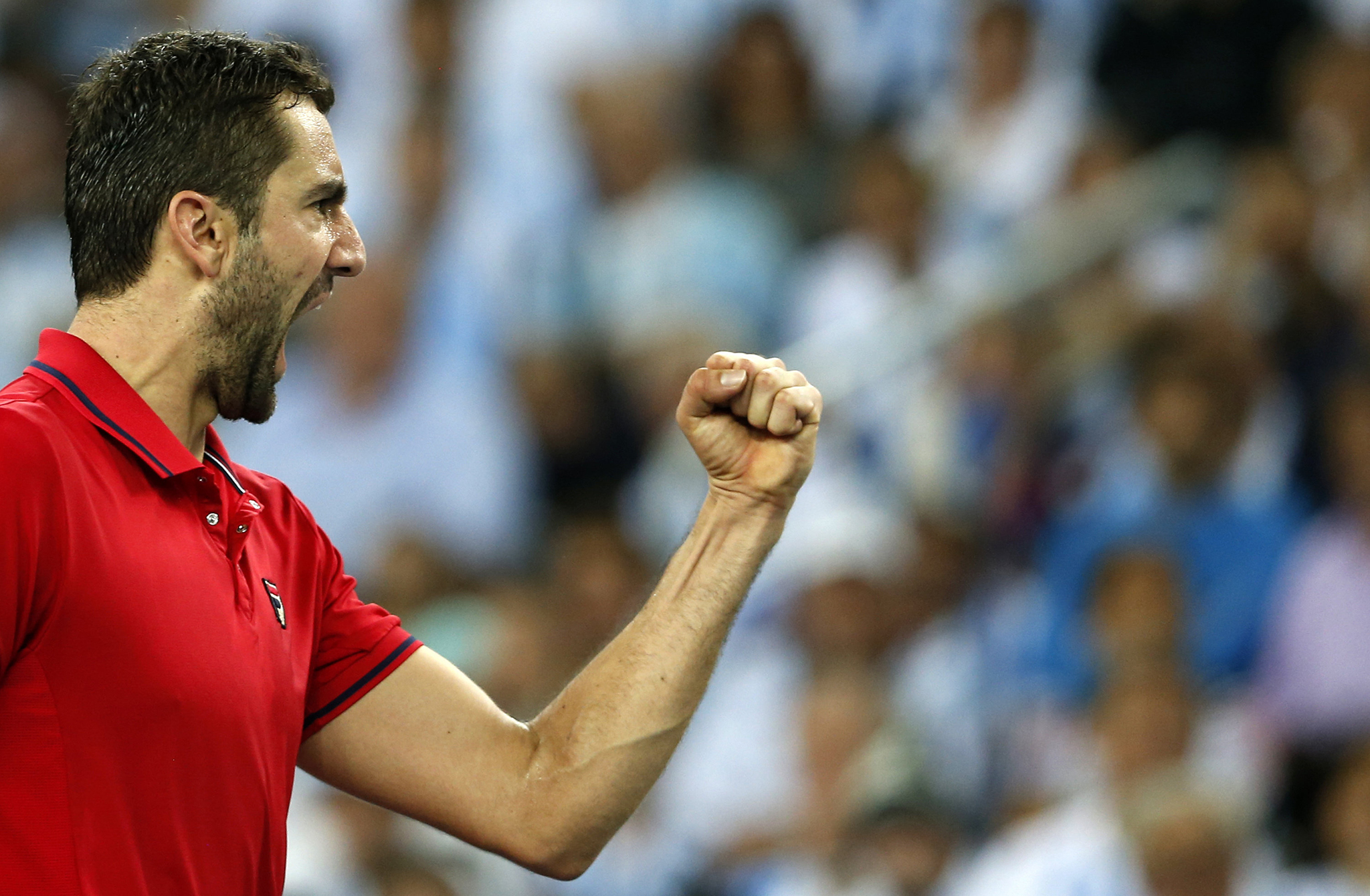 Croatia's Marin Cilic celebrates after winning a point against Argentina's Federico Delbonis, during their singles match at the Davis Cup tennis tournament final between the two countries in Zagreb, Croatia, Friday, Nov. 25, 2016. (AP Photo/Darko Vojinovic)