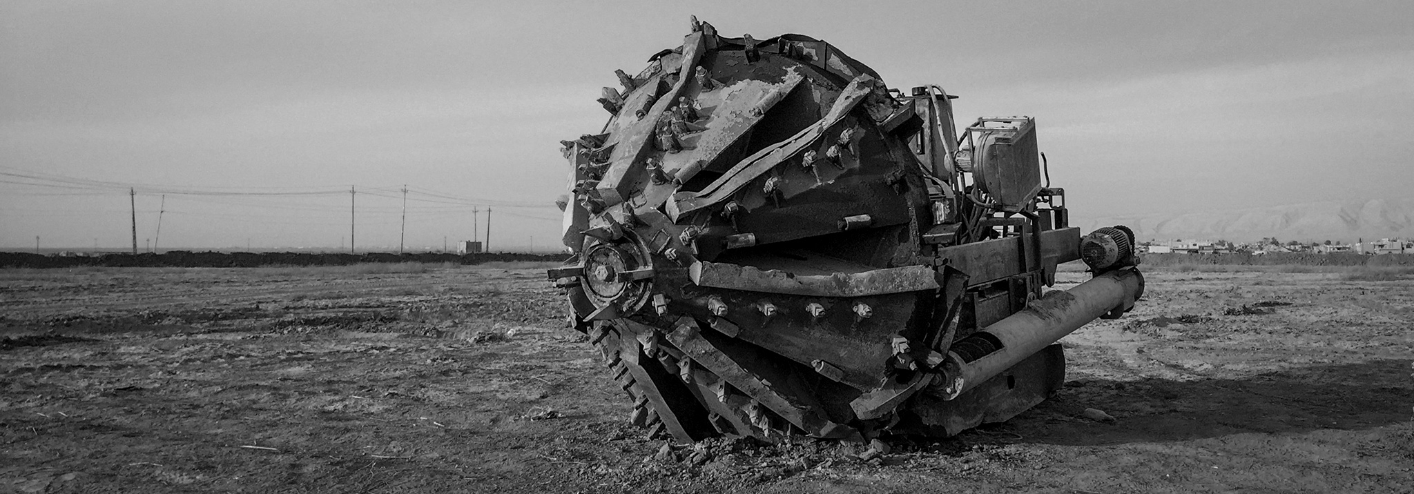 (EDITORS NOTE: Image shot in black and white using a panoramic app on an iPhone 6.) A machine used to dig ISIL tunnels is seen at the Iraqi Army Armoured Ninth Division base on November 13, 2016 in Qaraqosh, Iraq. ISIL took control of Mosul, Iraq's second largest city in June of 2014. For the past two years they have occupied the city. On the 17th of October 2016. Iraqi forces began the Mosul offensive to take back the city. The offensive was a joint effort by Iraqi Government forces, the Peshmerga, local tribal militias and air support from the US and UK military. Despite early progress the offensive has slowed in the past week as Iraqi forces encountered heavy resistance from ISIL fighters entrenched inside the city. The use of an extensive tunnel system under the city built by ISIL over the past two years, booby traps, snipers and roads riddled with IED's has slowed the advance of troops on the ground. As the offensive enters its fourth week, fears of a humanitarian crisis grow as up to 1 million civilians are believed to be trapped inside the city.  (Photo by Chris McGrath/Getty Images)