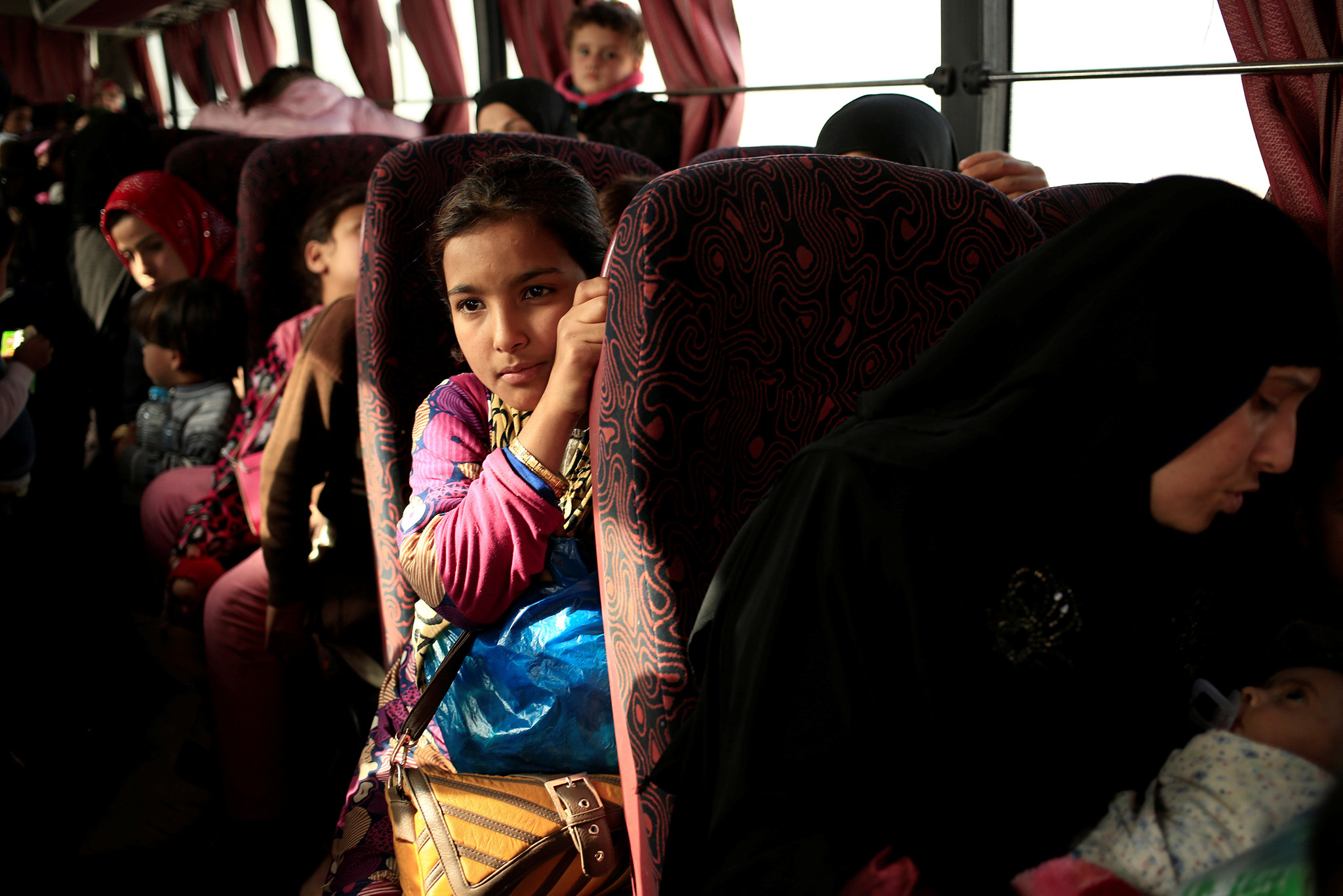 A girl who is fleeing the fighting between Islamic State and the Iraqi army in Mosul sits inside a bus at a Peshmerga checkpoint in Iraq November 14, 2016. REUTERS/Zohra Bensemra