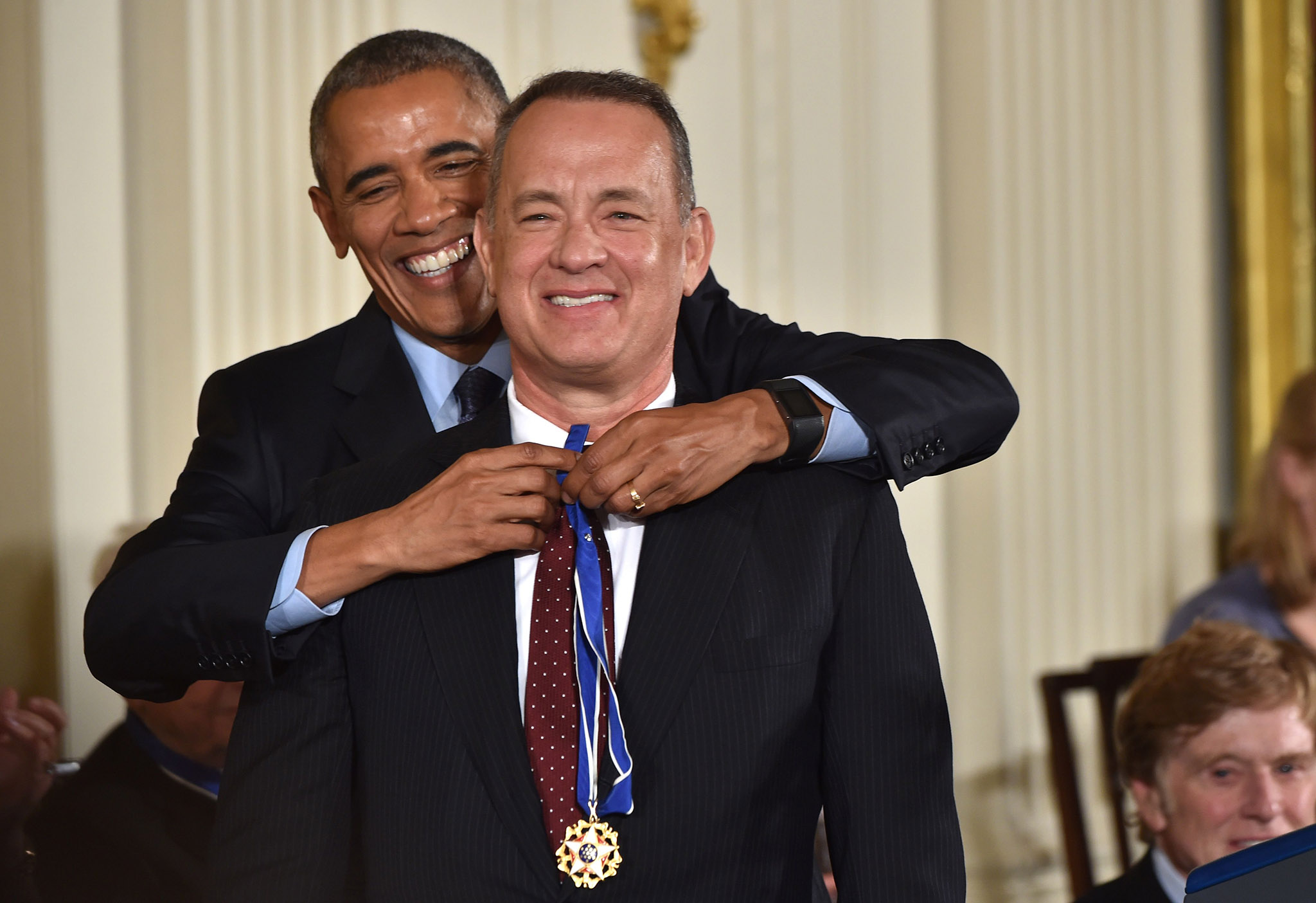 US President Barack Obama presents actor Tom Hanks with the Presidential Medal of Freedom, the nation's highest civilian honor, during a ceremony honoring 21 recipients, in the East Room of the White House in Washington, DC, November 22, 2016. / AFP PHOTO / Nicholas KammNICHOLAS KAMM/AFP/Getty Images