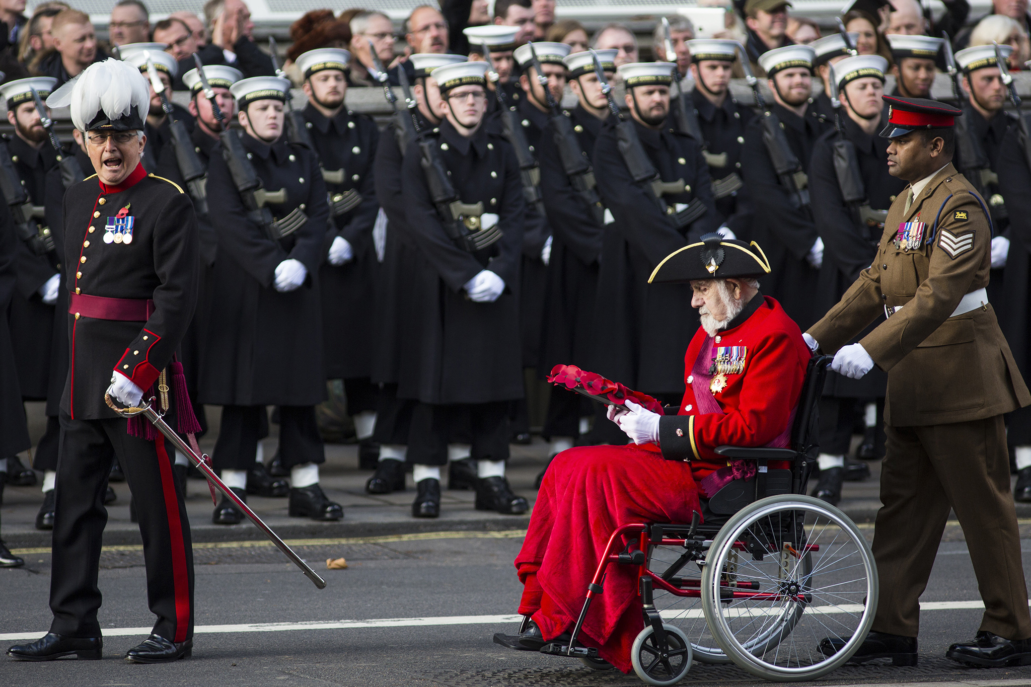 Victoria Cross holders Bill Speakman, (2nd R) and Johnson Beharry (R) parade during the annual Remembrance Sunday Service at the Cenotaph on Whitehall on November 13, 2016 in London, England. The Queen, senior politicians, including the British Prime Minister and representatives from the armed forces pay tribute to those who have suffered or died at war. (Photo by Jack Taylor/Getty Images)