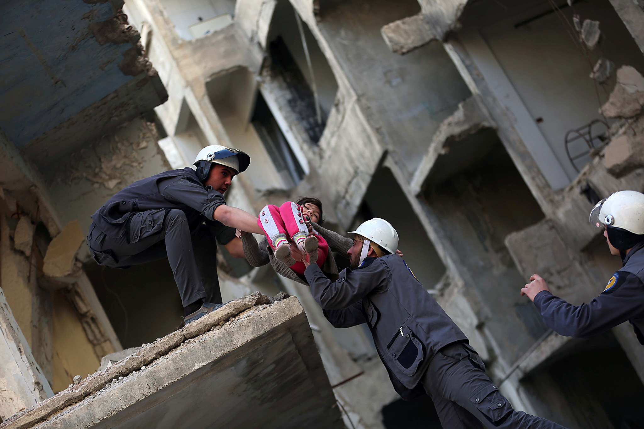 Members of the Syrian Civil Defence, known as the White Helmets, evacuate a child during a training session in the rebel-held eastern Ghouta area, east of the capital Damascus, on November 22, 2016.   / AFP PHOTO / AMER ALMOHIBANYAMER ALMOHIBANY/AFP/Getty Images