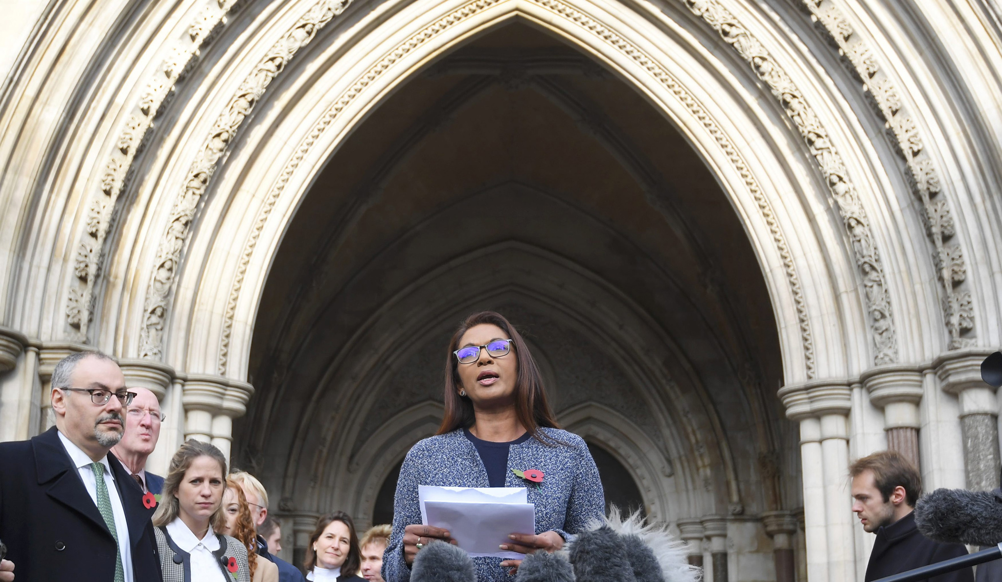 Gina Miller speaks outside the High Court following its ruling on a challenge to the British government's right to start divorce proceedings from the European Union, in central London