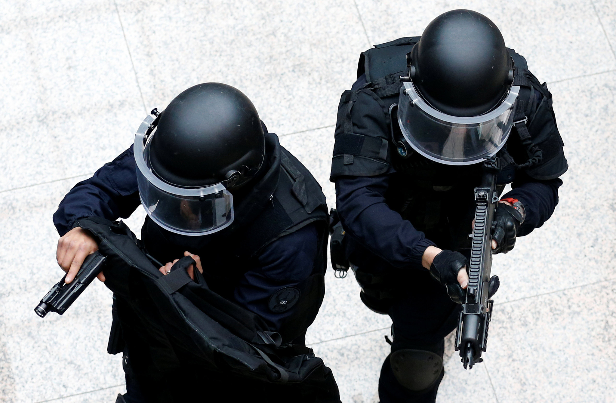 Members of French special police forces of Research and Intervention Brigade (BRI) take part in a mock terrorist attack inside the European Council building in Brussels, Belgium