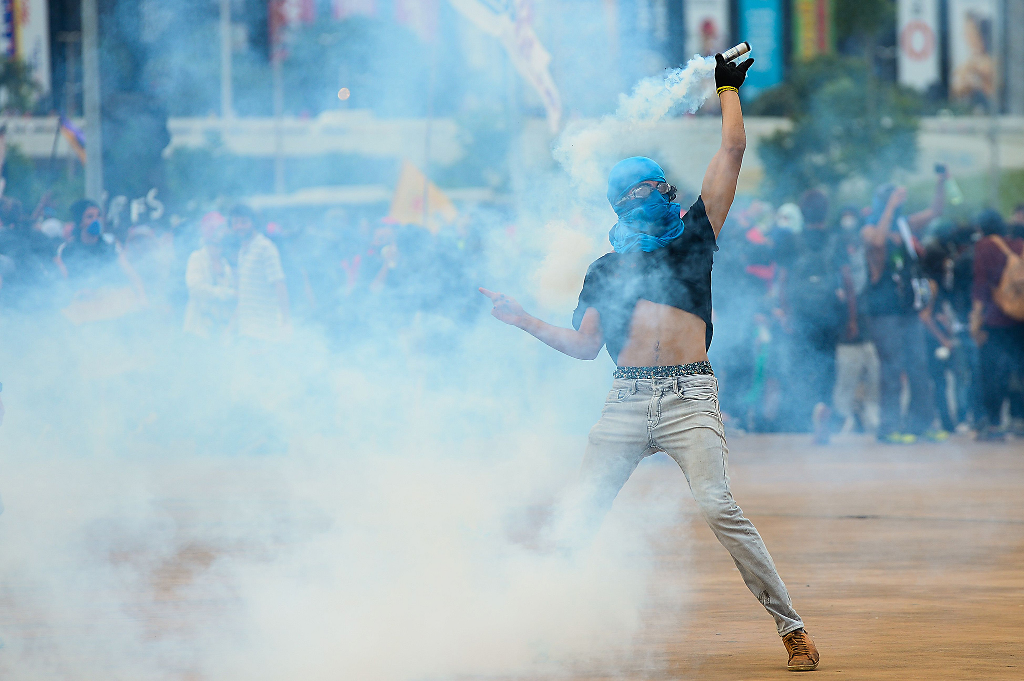 Demonstrators clash with police during a protest in front of the National Congress in Brasilia on December 13, 2016.  Brazil's Senate approved Tuesday a 20-year freeze on government spending billed as the centerpiece of austerity reforms aimed at restoring economic health to the troubled Latin American giant. / AFP PHOTO / ANDRESSA ANHOLETEANDRESSA ANHOLETE/AFP/Getty Images