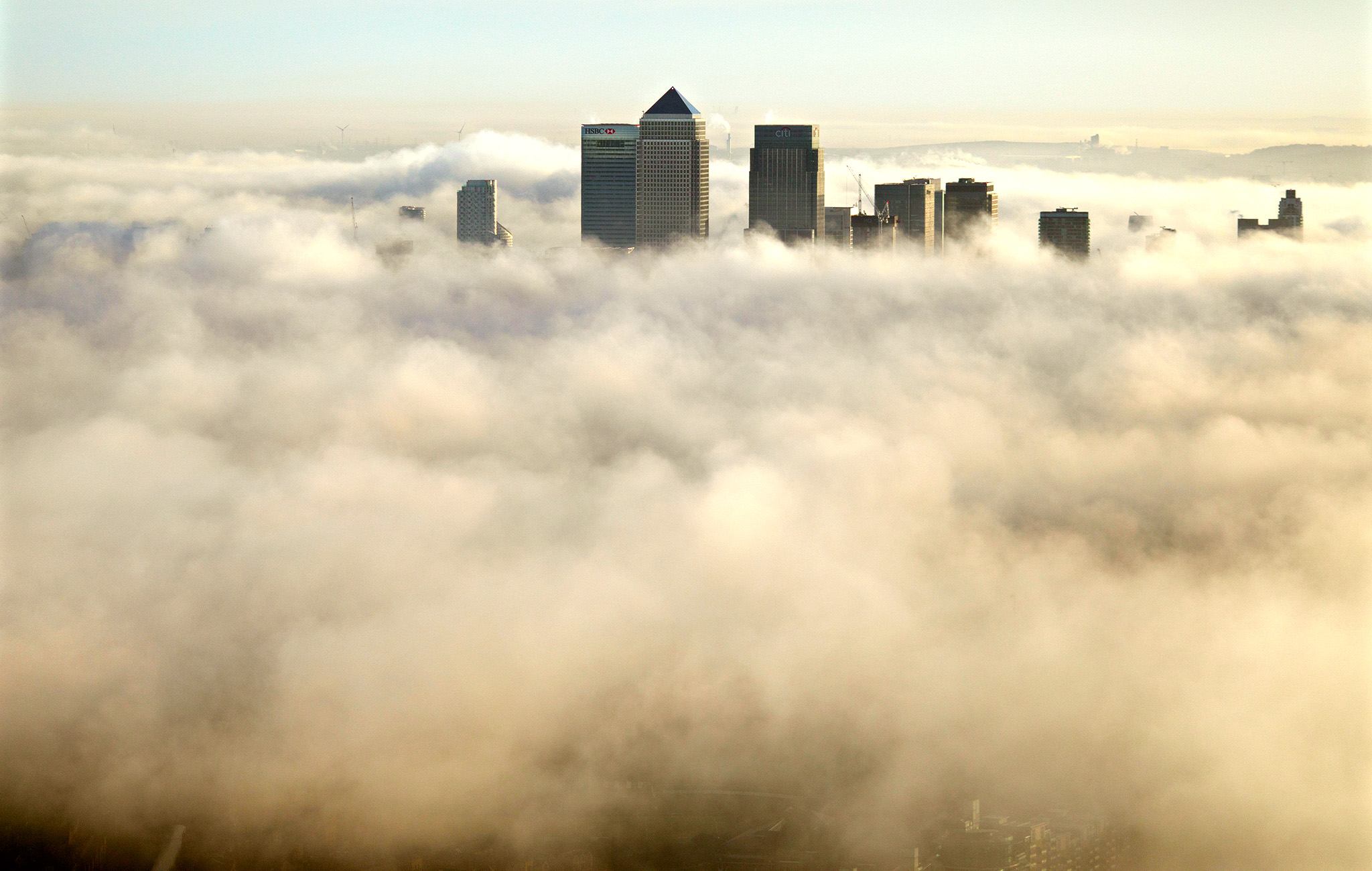 Canary Wharf and the fog around London as seen from the Shard