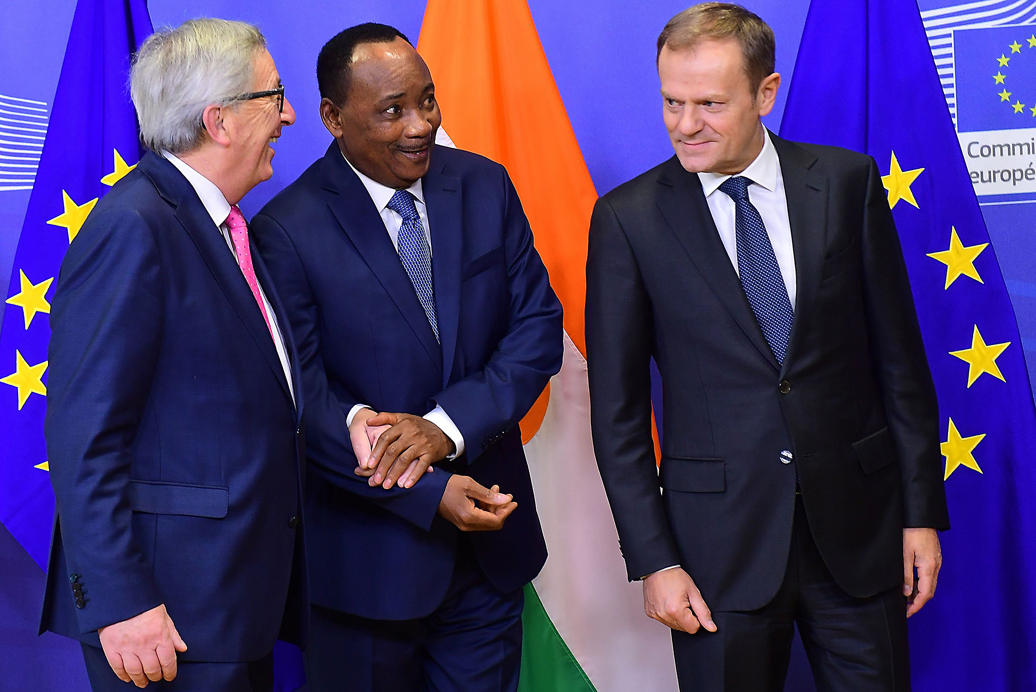 Niger's President Mahamadou Issoufou (C)  is welcomed by European Commission President Jean-Claude Juncker (L) and European Council President Donald Tusk at the European Commission in Brussels, December 15, 2016.   / AFP PHOTO / EMMANUEL DUNANDEMMANUEL DUNAND/AFP/Getty Images