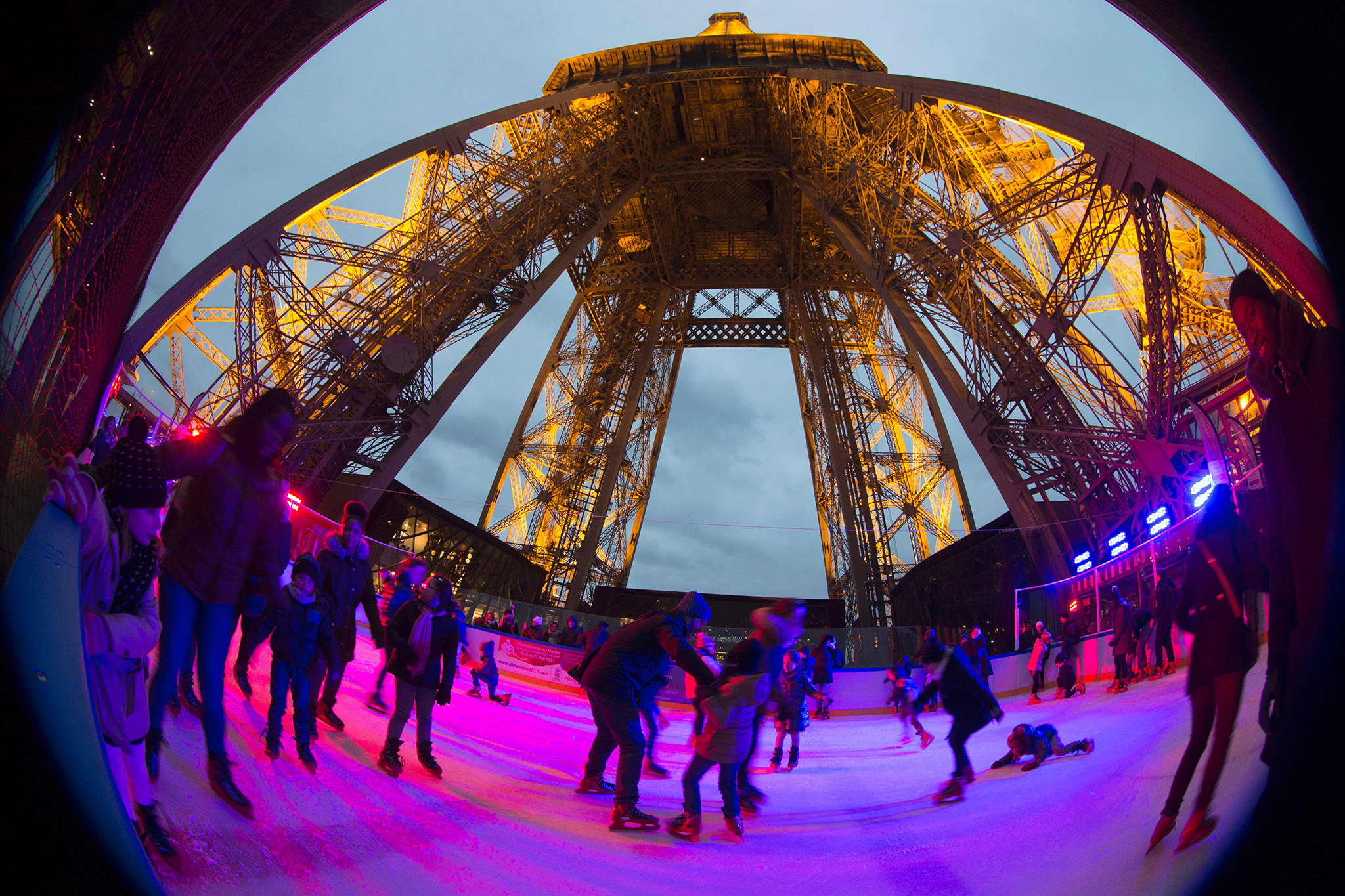 People enjoy skating at the open air Christmas ice rink on the first floor of the Eiffel Tower after its reopening on December 19, 2016 in Paris. The ice rink of about 200 square metres and on the first floor of the tower (57 metres above the ground) is open to the public until February 19, 2017. / AFP PHOTO / JOEL SAGETJOEL SAGET/AFP/Getty Images