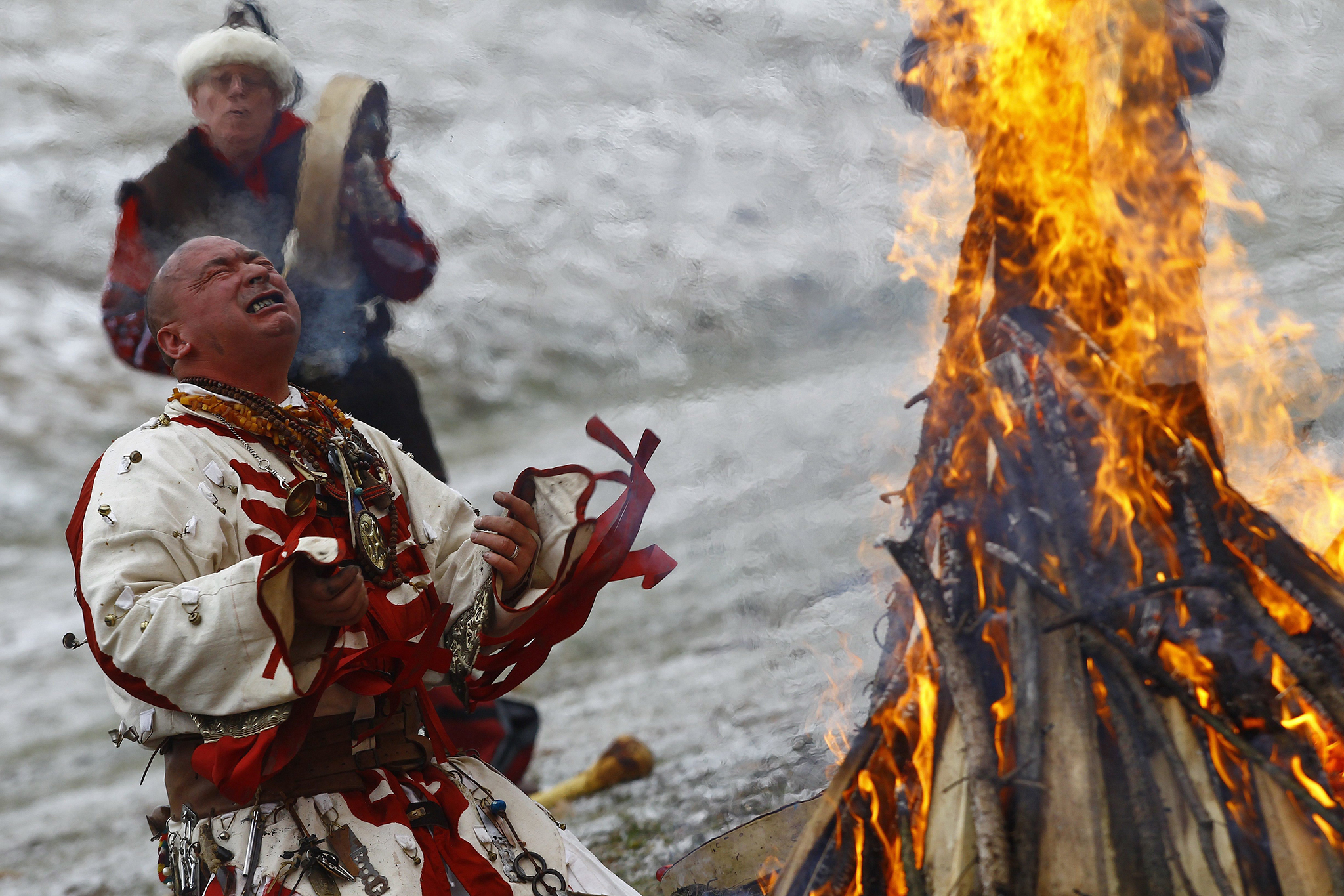 ungarian Artist Miklos Zoltan Baji performs a shamanic ritual around a bonfire during winter solstice celebrations in Bekescsaba, 200 kms southeast of Budapest, Hungary, Wednesday, Dec 21, 2016, on the shortest day of the year. (Peter Lehoczky/MTI via AP)