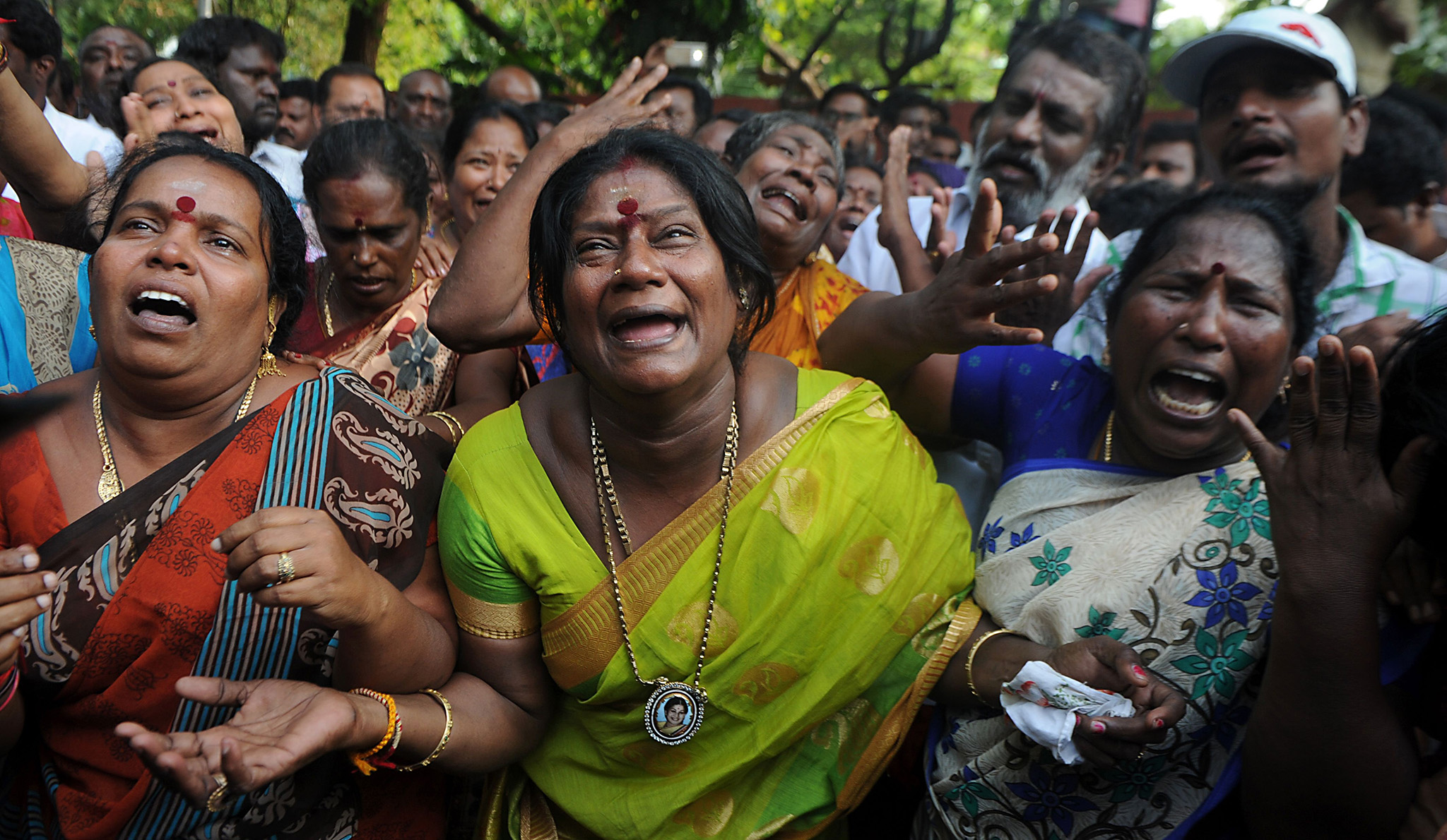 Indian supporters of the Chief Minister of Tamil Nadu Jayalalithaa Jayaram react outside the hospital where she is being treated after false reports that she had died in Chennai on December 5, 2016.  Scuffles broke out December 5 outside the hospital where one of India's most popular political leaders Jayalalithaa Jayaram is on life support after suffering a cardiac arrest. / AFP PHOTO / ARUN SANKARARUN SANKAR/AFP/Getty Images