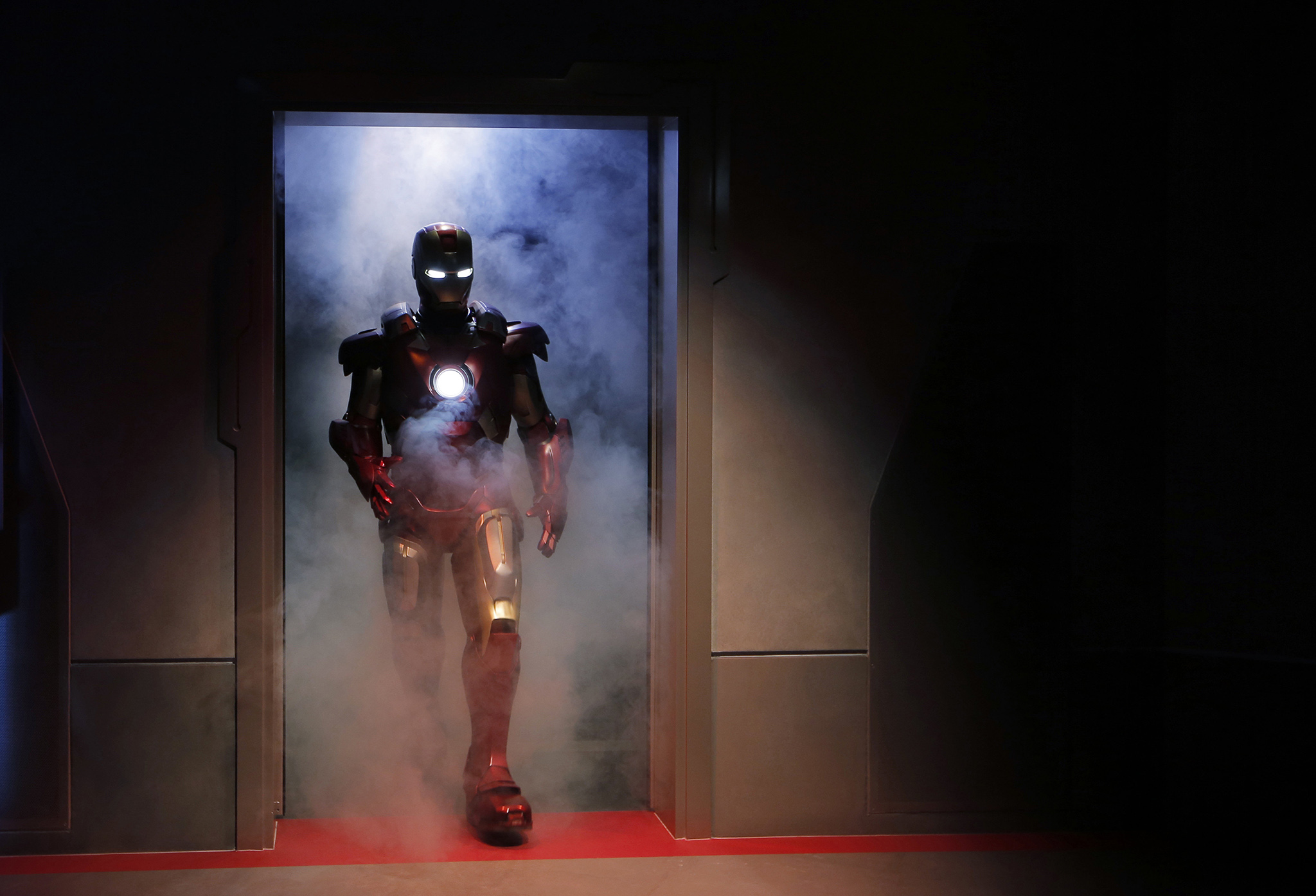 "A performer dressed as the Marvel comic character Iron Man arrives at the new attraction ""Iron Man Experience"" during a media tour in Hong Kong Disneyland, Wednesday, Dec. 14, 2016. Hong Kong Disneyland added an Iron Man-themed area in the hopes that the Marvel superhero's success at the Chinese box office will help draw more visitors to the underachieving resort. The Iron Man Experience include a thrill ride that will let visitors ""take flight with Iron Man on an epic adventure"" involving a ""battle against alien invaders"" across Hong Kong. (AP Photo/Kin Cheung)"