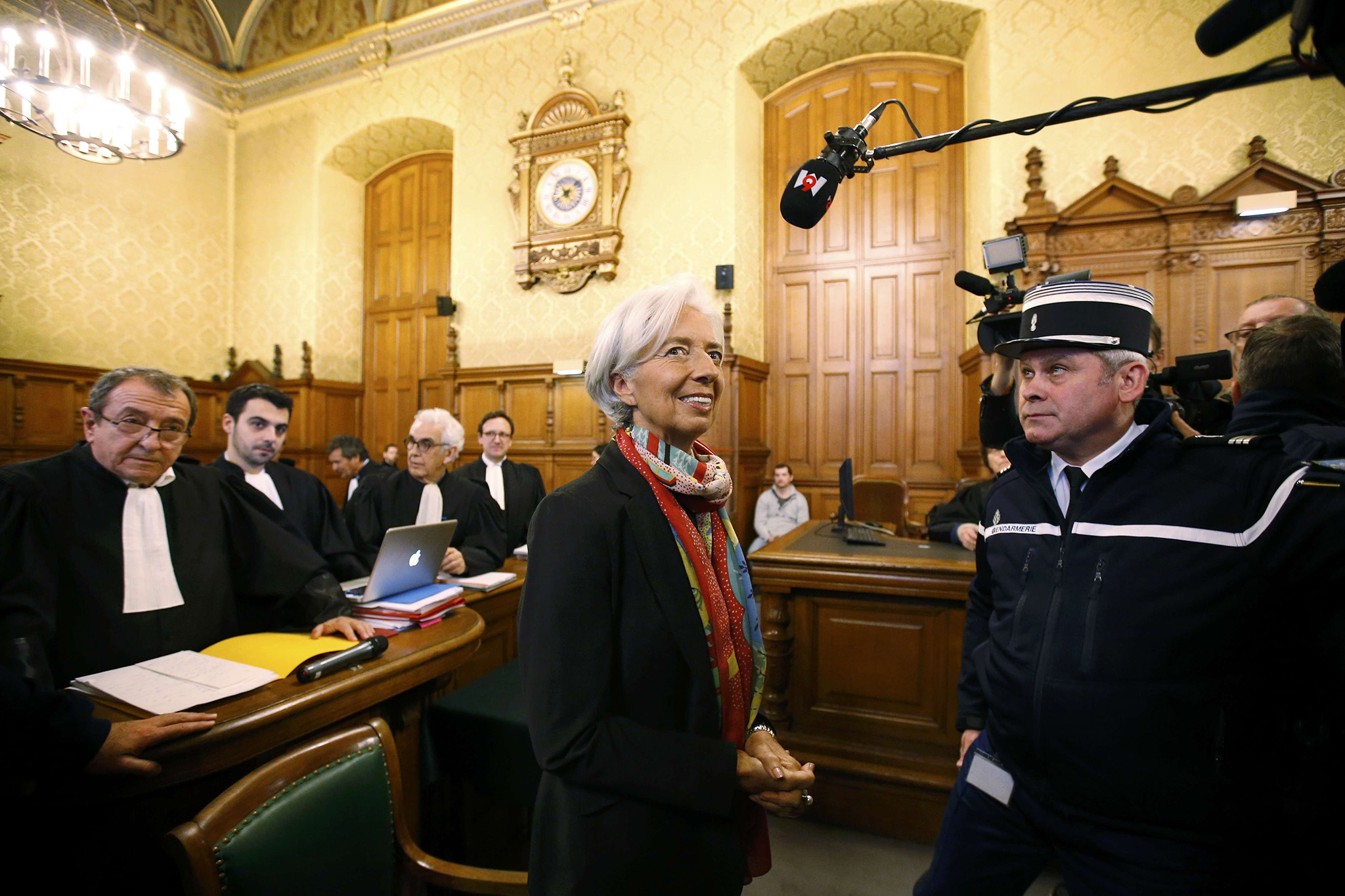 Managing Director of the International Monetary Fund (IMF) Christine Lagarde stands near her lawyer Patrick Maisonneuve (L) before the start of her trial about a state payout in 2008 to a French businessman, at the courts in Paris, France, December 12, 2016.   REUTERS/Charles Platiau