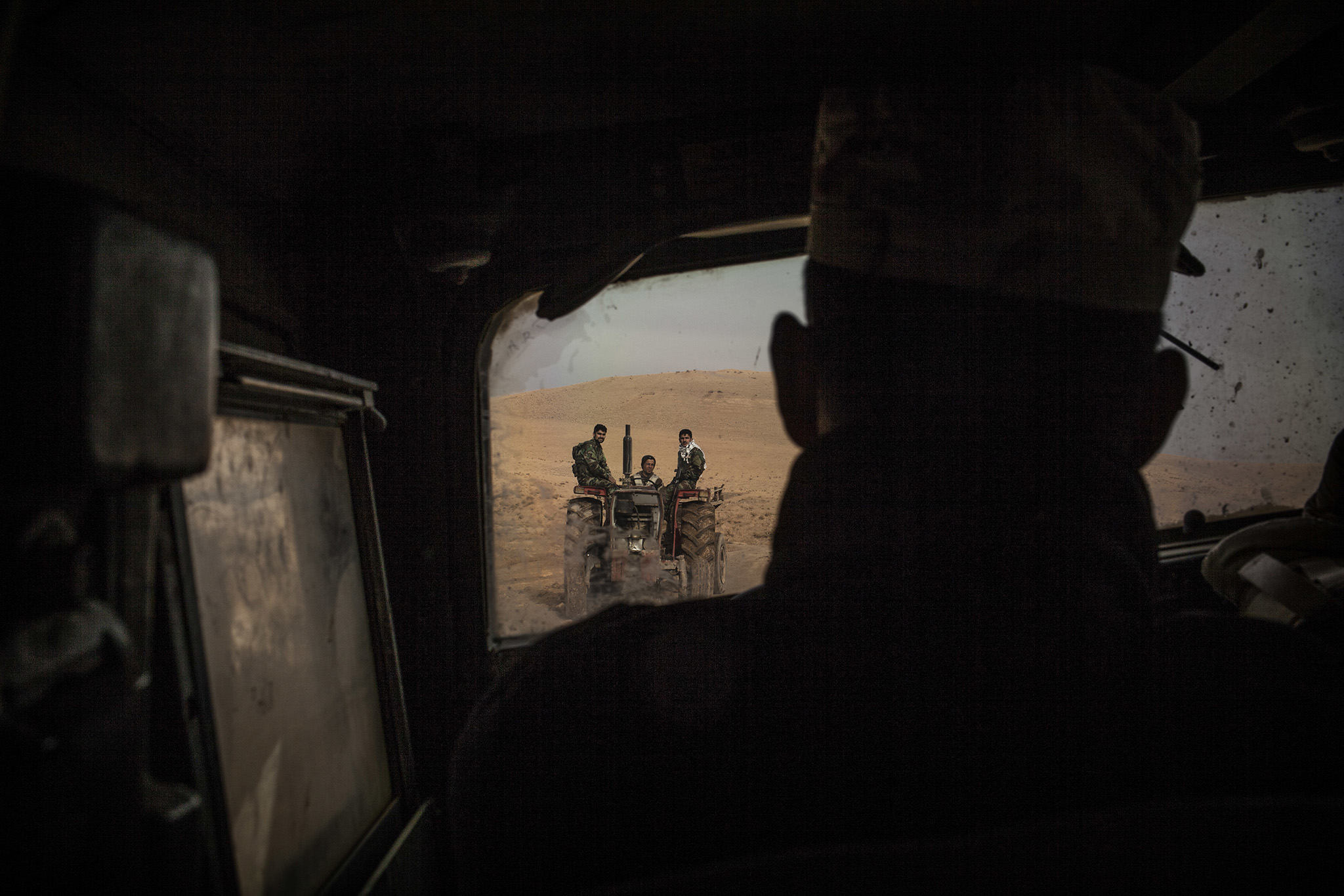Iraqi soldiers are seen in a tractor from a Humvee while coming back from the frontline in the Al-Intisar district in Mosul, Iraq, Monday, Dec. 5, 2016. Mosul, Iraq's second-largest city, is the last major Islamic State extremist urban bastion in the country. Iraqi troops have advanced cautiously to avoid civilian casualties. (AP Photo/Manu Brabo)