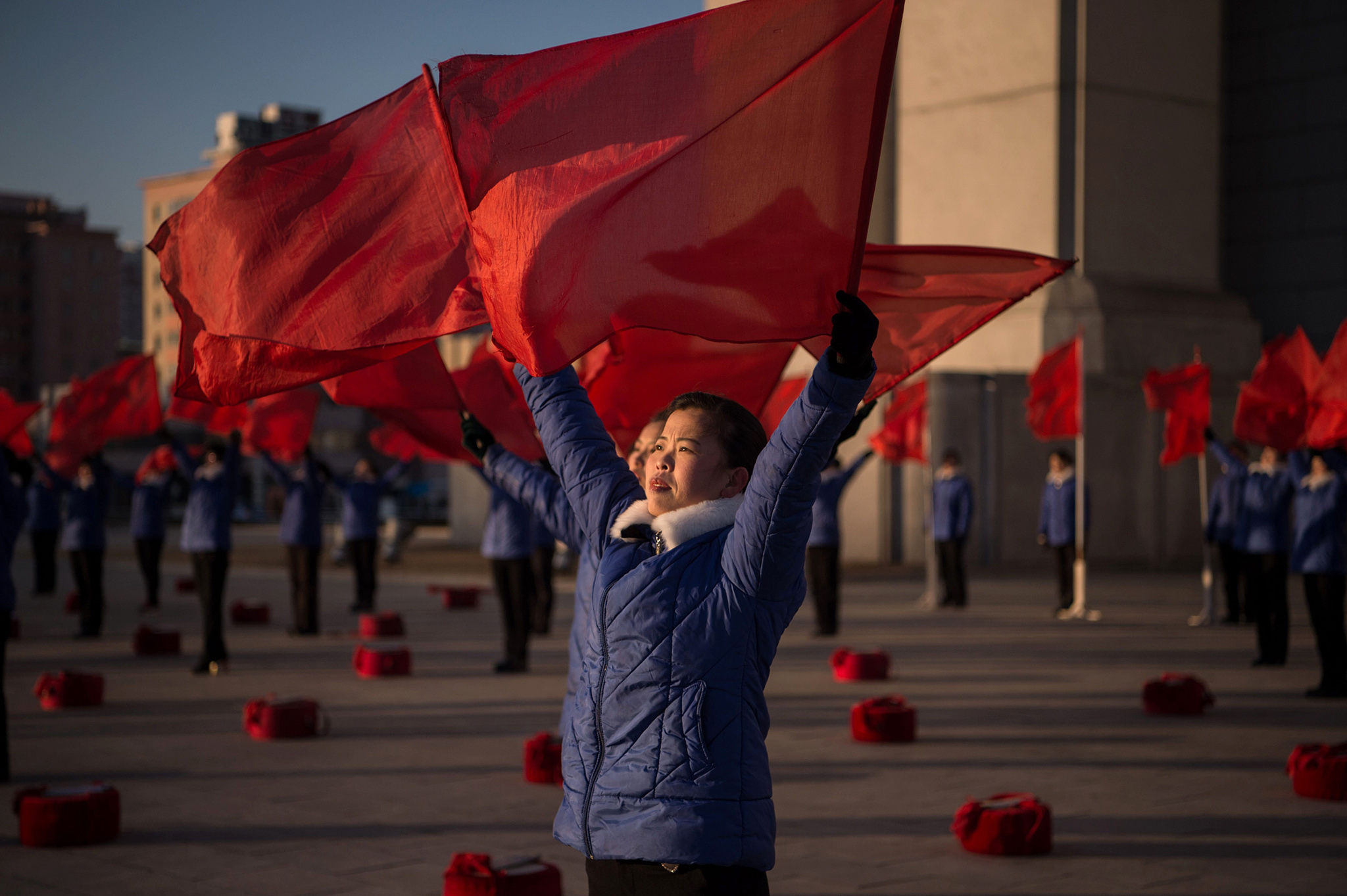 A propaganda troupe perform before the Arch of Triumph on the last day of the 200-day campaign in Pyongyang on December 15, 2016. North Korea wrapped up a 200-day mass mobilisation campaign aimed at boosting an economy struggling with upgraded UN sanctions imposed after its two nuclear tests this year. Coming hard on the heels of a similar 70-day campaign that ended in May, the 200-day version kicked off in early June, pushing extra hours and working weekends.  / AFP PHOTO / KIM Won-JinKIM WON-JIN/AFP/Getty Images