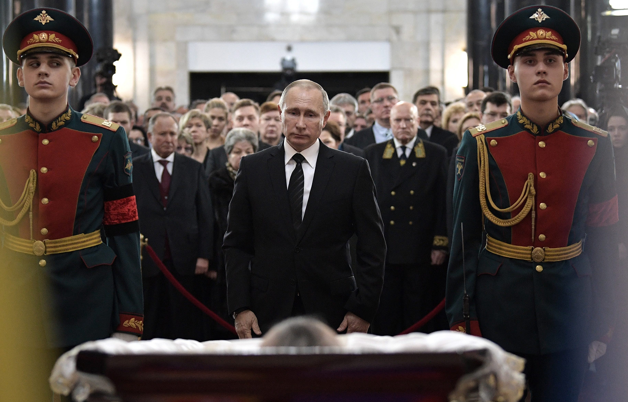 epa05685384 Russian President Vladimir Putin (C) pays last respects at the coffin of killed Russian ambassador to Turkey, Andrey Karlov, during a memorial service for Andrey Karlov at the Russian Foreign Ministry building in Moscow, Russia, 22 December 2016. Russia's ambassador to Turkey, Karlov was assasinated on 19 December during a culutural event at an art gallery in the Turkish capital by Turkish policeman Mevlut Mert Altintas, 22, who had been serving in Ankara's riot police for two years.  EPA/ALEXEY NIKOLSKY / SPUTNIK