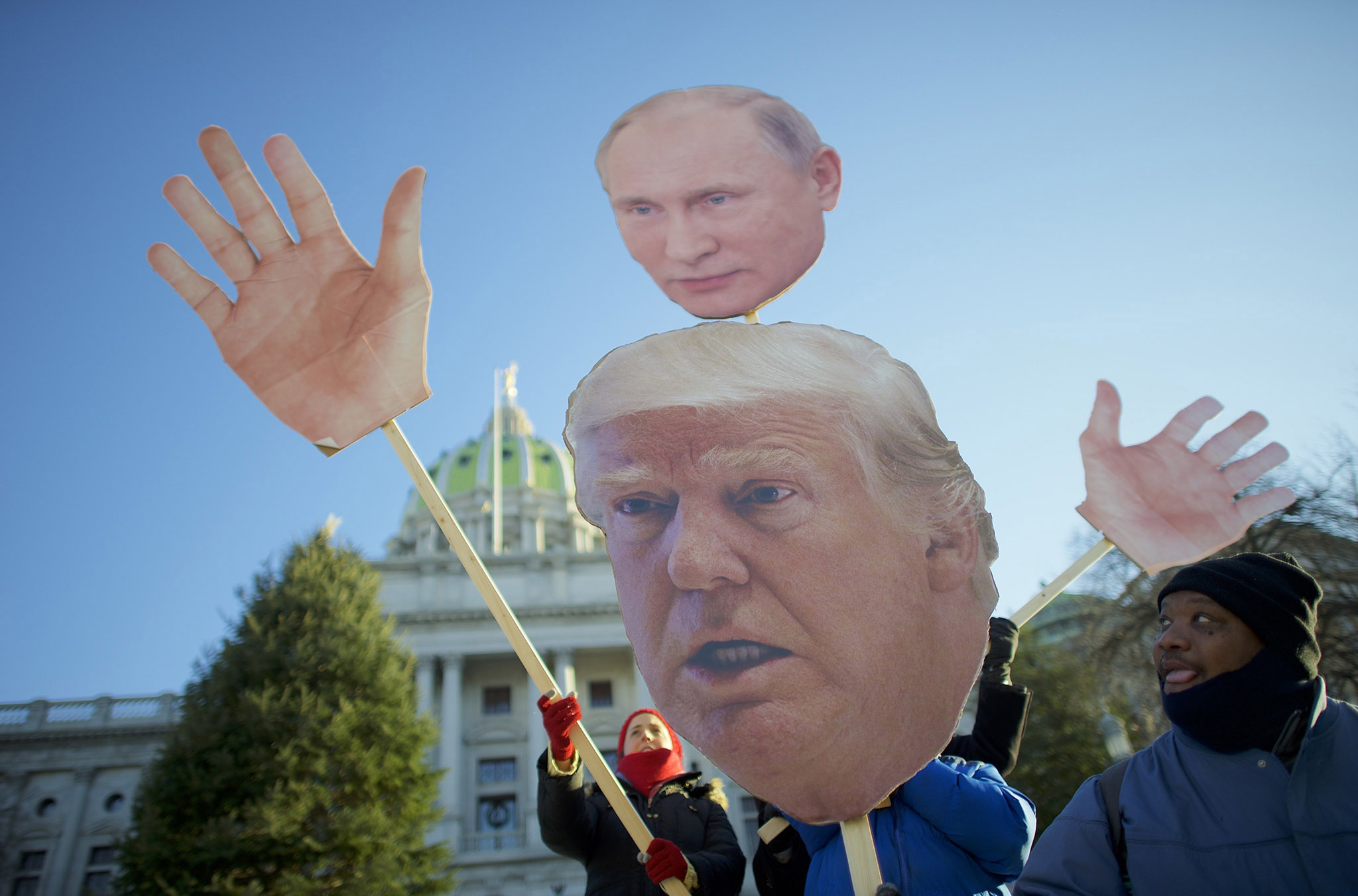Donald Trump protestors demonstrate outside the Pennsylvania Capitol Building before electors arrive to cast their votes from the election at December 19, 2016 in Harrisburg, Pennsylvania.  Electors from all 50 states cast votes today in their respective state capitols.  Donald J. Trump won Pennsylvania by less than 1%, the first Republican to carry the state since George H.W. Bush 1992.  (Photo by Mark Makela/Getty Images)