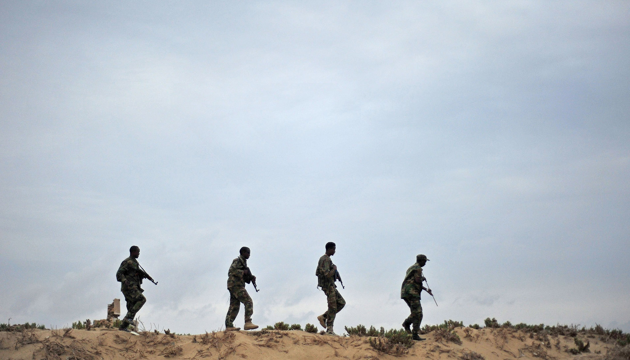 Somali security forces patrol along the coast of Qaw, in Puntland, northeastern Somalia on December, 18, 2016. Armed militants groups have become more active in the Puntland's region, northern Somalia, since being pushed out of their strongholds in southern Somalia by African Union forces and the Somali National Army. / AFP PHOTO / Mohamed ABDIWAHABMOHAMED ABDIWAHAB/AFP/Getty Images