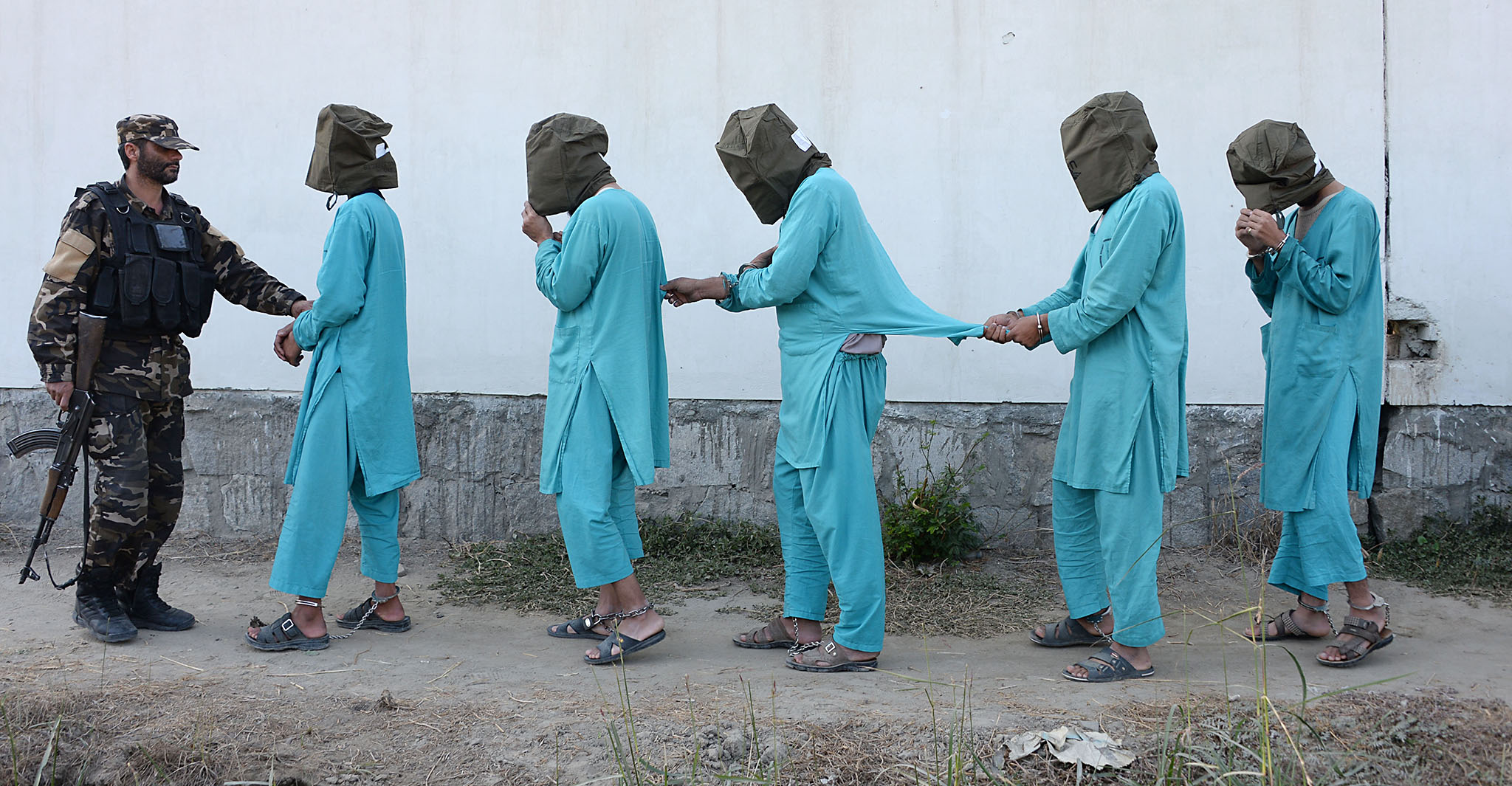 Suspected Islamic State (IS) and Taliban militants are brought before media during a press conference in Jalalabad on December 6, 2016. Afghan National Directorate Security (NDS) forces arrested three suspected Islamic State (IS) fighters and eight Taliban insurgents during an operation in different part of Jalalabad city, officials said. / AFP PHOTO / NOORULLAH SHIRZADANOORULLAH SHIRZADA/AFP/Getty Images
