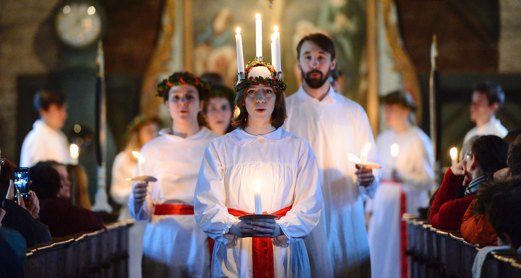 he 'Kongl. Teknologkoren' choir performs in Seglora church at the open-air museum Skansen in Stockholm, Sweden on Saint Lucy's Day, on December 13, 2016.    Saint Lucy's Day is a Christian feast day celebrated on 13 December in Advent, most commonly in Scandinavia. / AFP PHOTO / TT News Agency / Henrik MONTGOMERY / Sweden OUTHENRIK MONTGOMERY/AFP/Getty Images