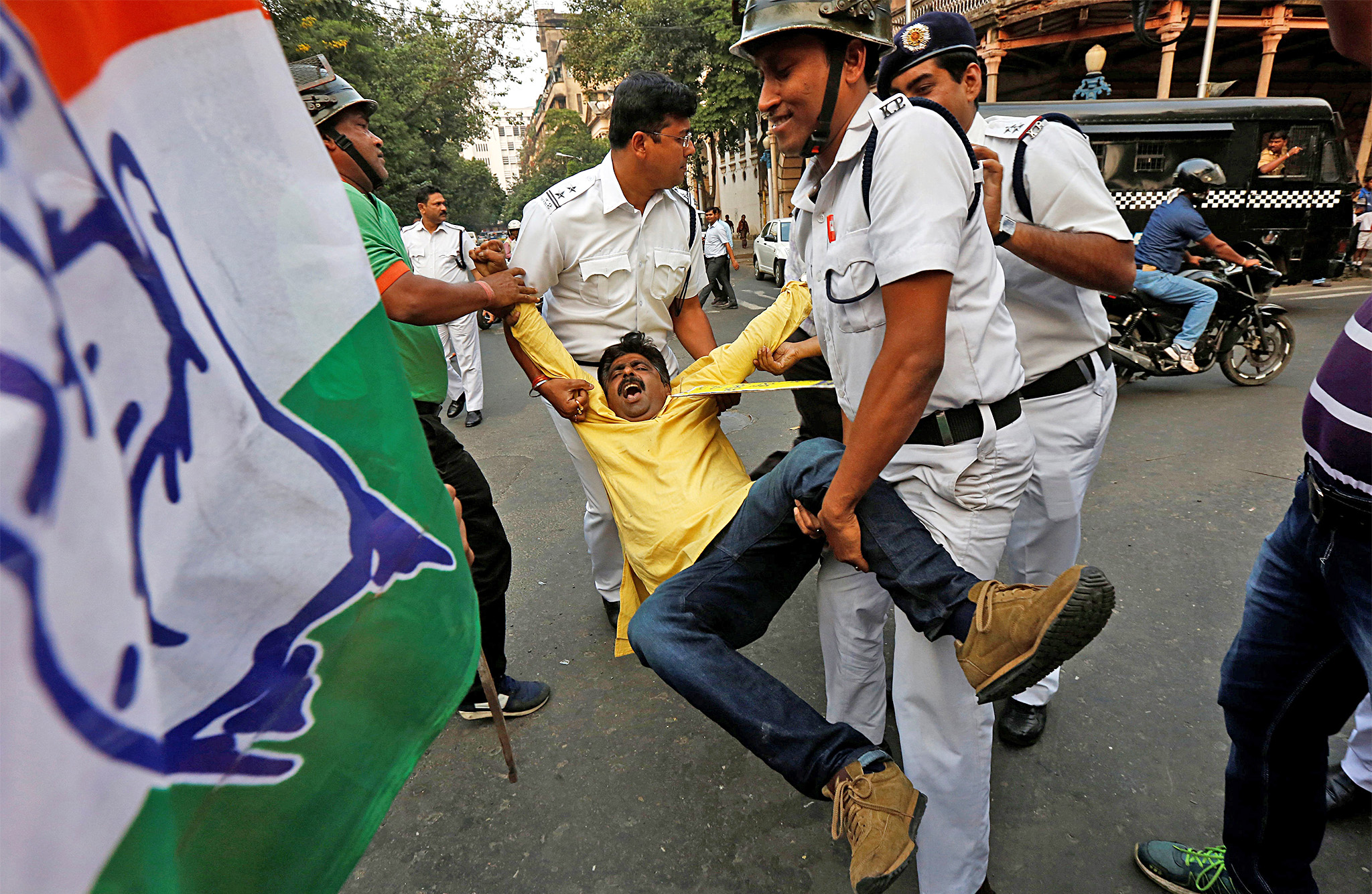 Police detain a protester from India's main opposition Congress party during a protest in Kolkata
