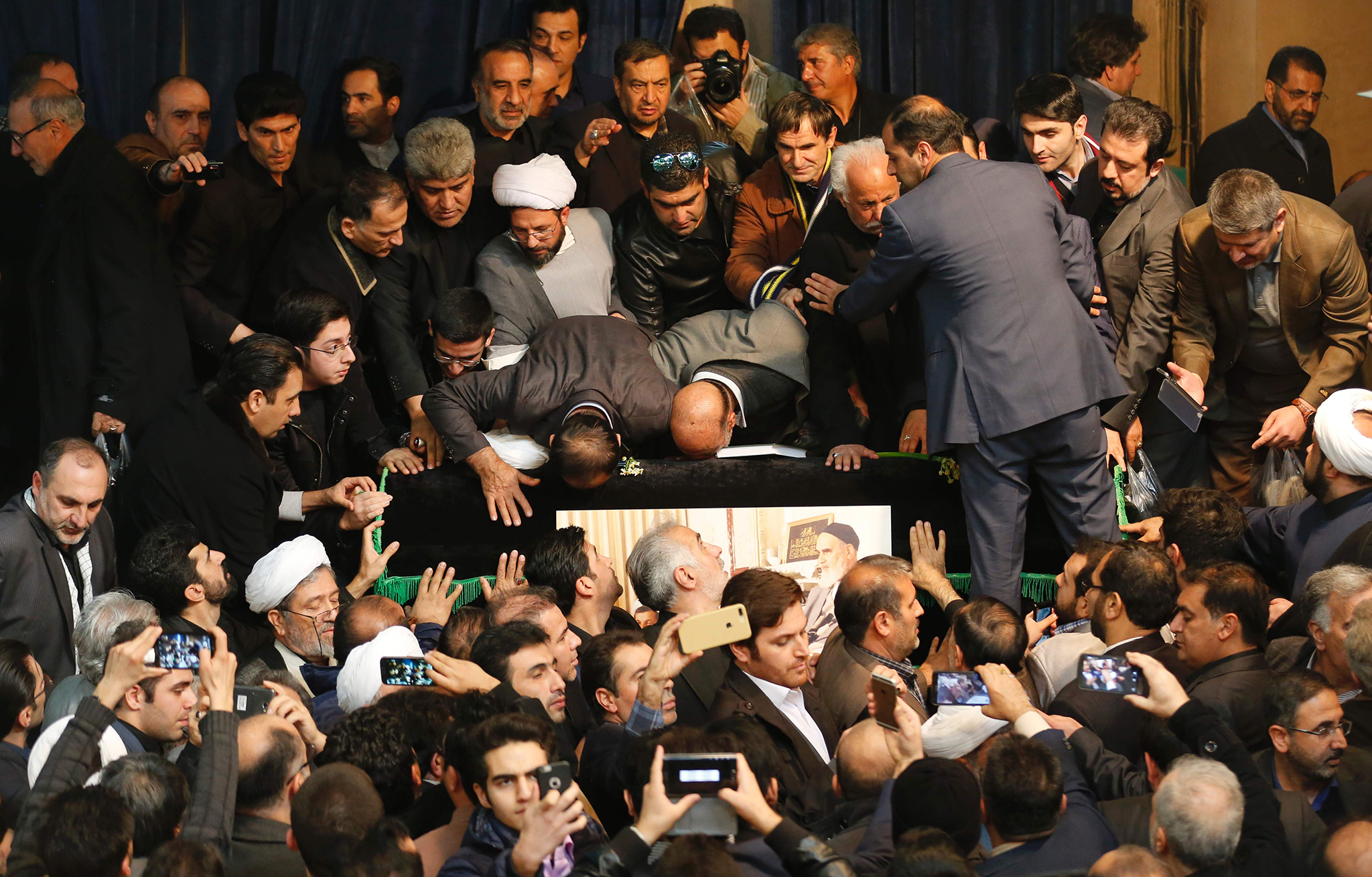 Mourners gather around the coffin of former Iranian president Akbar Hashemi Rafsanjani during a mourning ceremony at Jamaran mosque in Tehran, on January 9, 2017. Rafsanjani died in hospital on January 8 after suffering a heart attack. Rafsanjani, who was 82, was a pivotal figure in the foundation of the Islamic republic in 1979, and served as president from 1989 to 1997. / AFP PHOTO / ATTA KENAREATTA KENARE/AFP/Getty Images